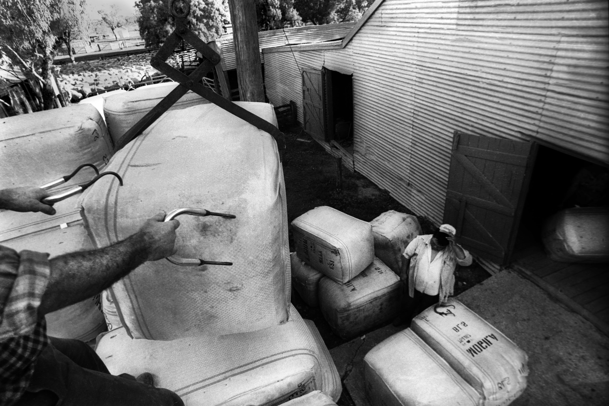 Bales of wool loaded upon a truck for initial transportation to wool storage facilities. Outback NSW, Australia. 1996