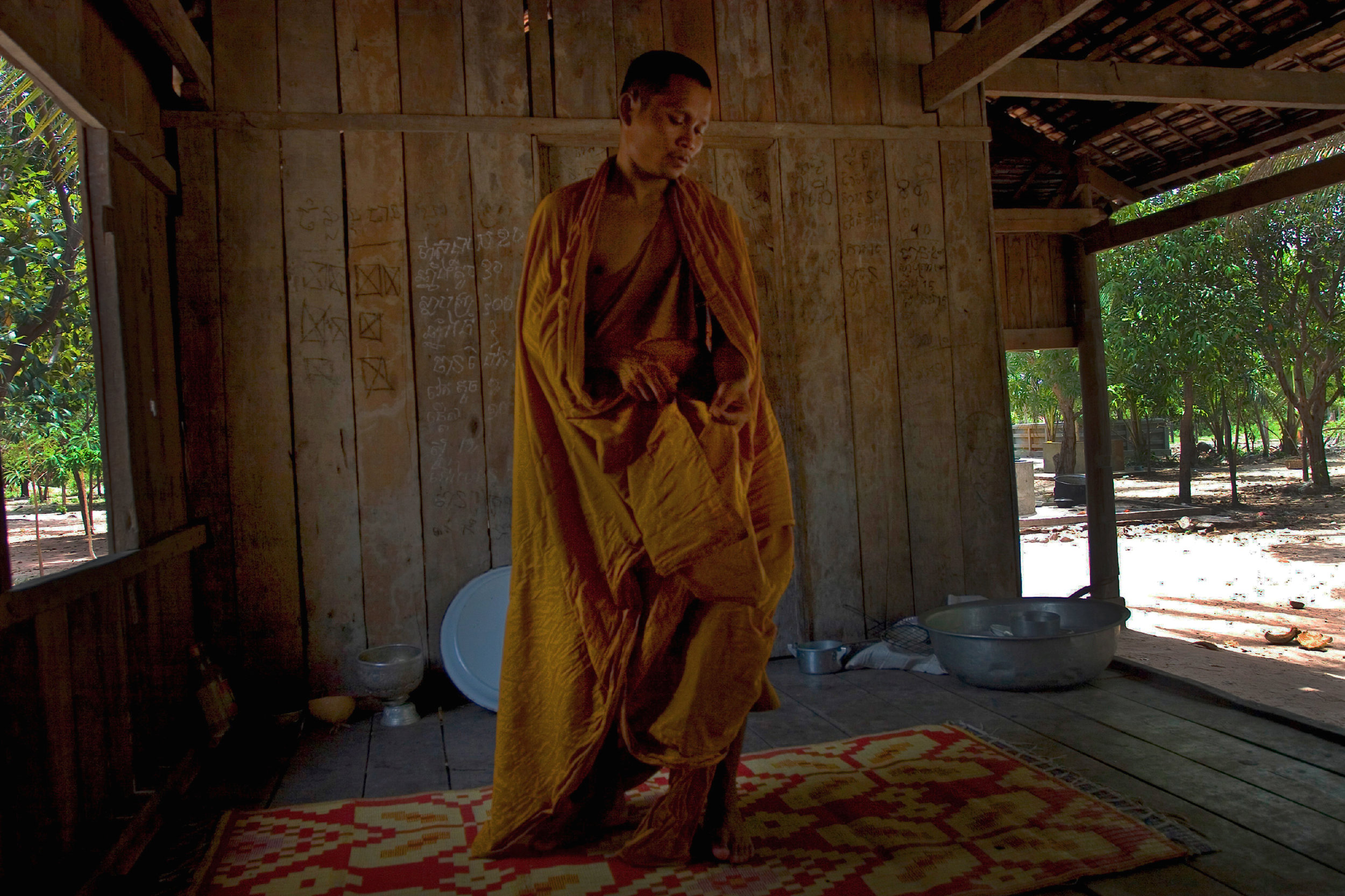 A Buddhist Monk suffering from Malaria awakes from a fitful sleep. Siem Reap district Cambodia. 2010