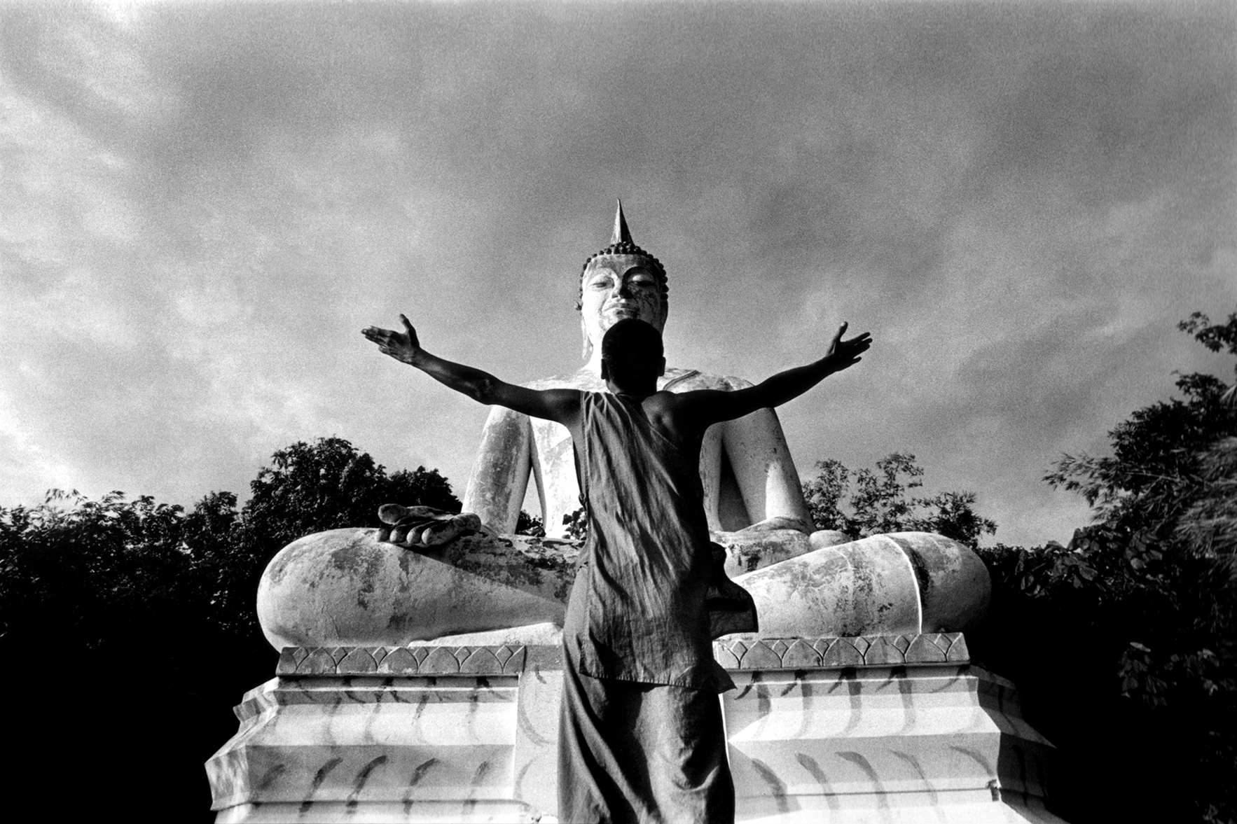 HIV+ Monk prays to Buddha. Lopburi, Thailand. 2003