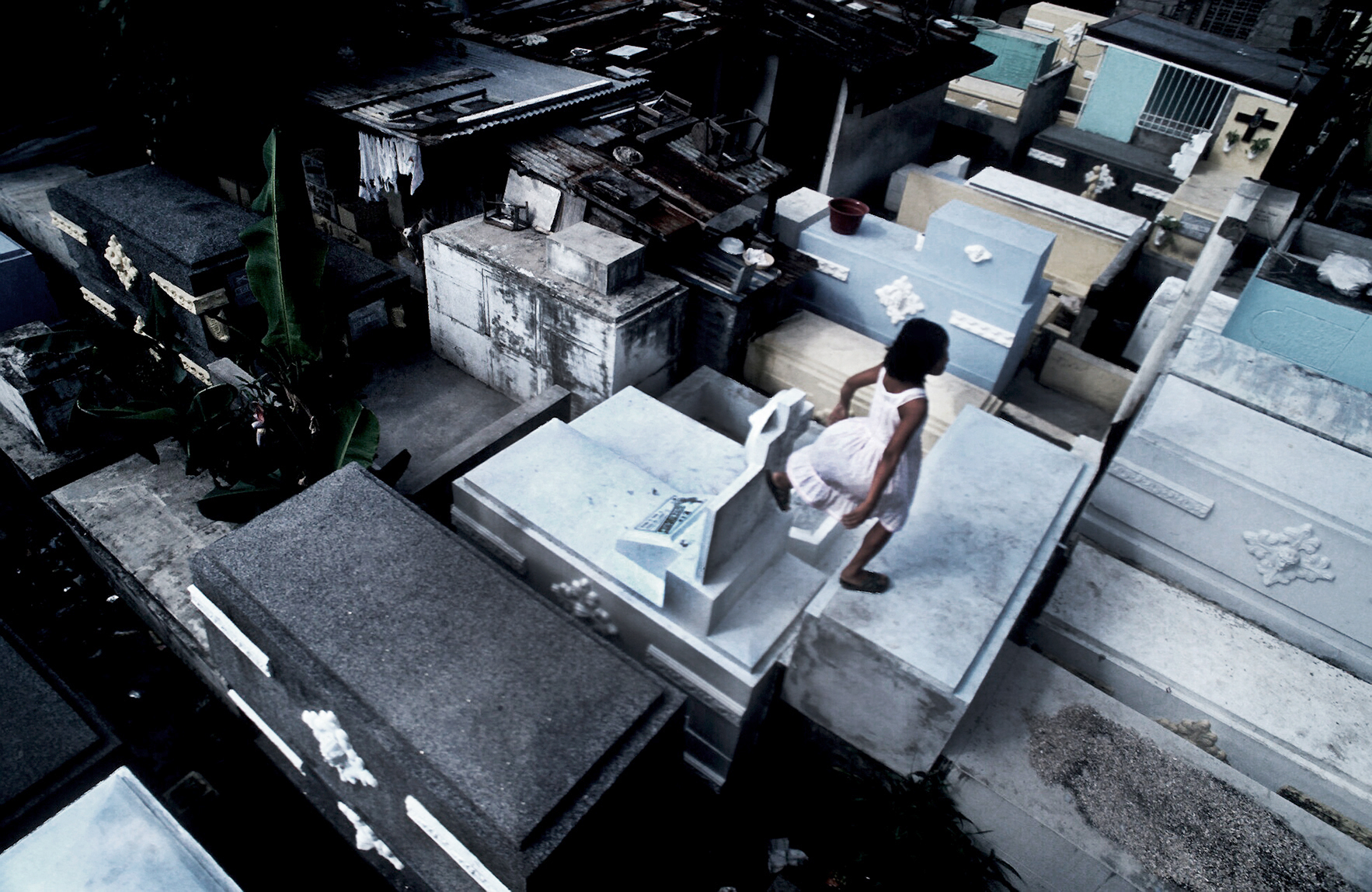 On the way to school. Manila's Catholic cemetery. The Philippines. 1994