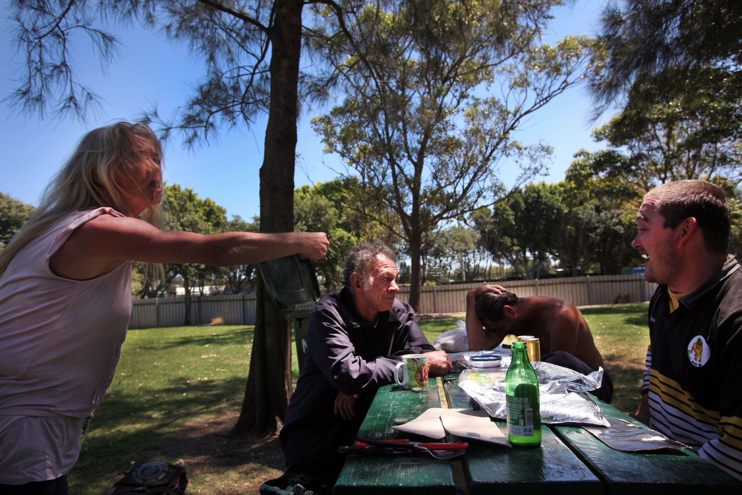 Denise delivers a volley of abuse at one of the other drinkers during a session in a local council park.