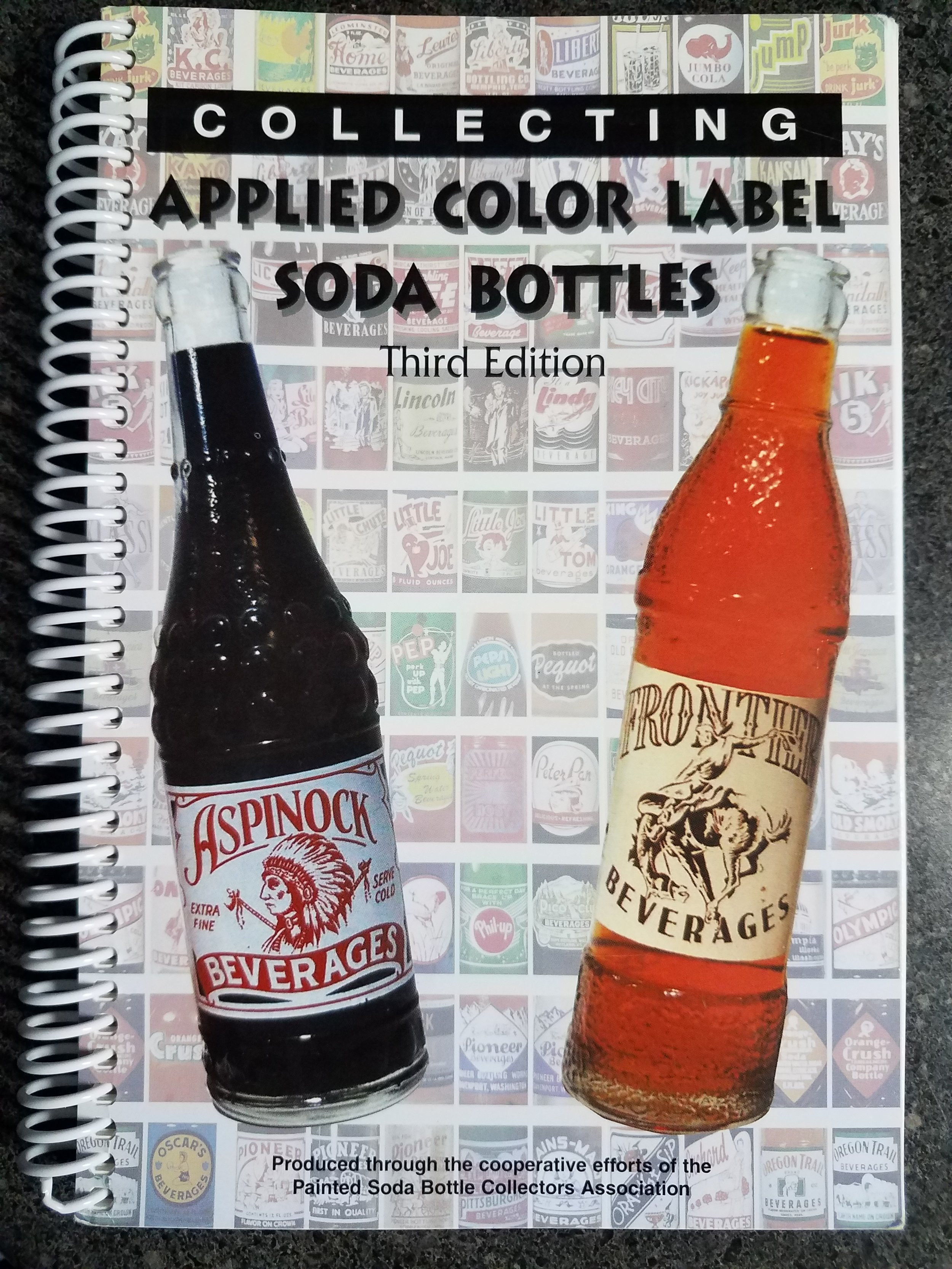 Collecting Applied Color Label Soda Bottles -Third Edition  - Published by Rick Sweeney on behalf of the Painted Soda Bottle Collectors Association (2002)Consider the bible of ACL soda collectors guides that contains listing of 1600+ bottles with 1,200 photos.. In addition the first half of the book provides great history of bottle manufacturing and many brand stories. A must have for any ACL collector