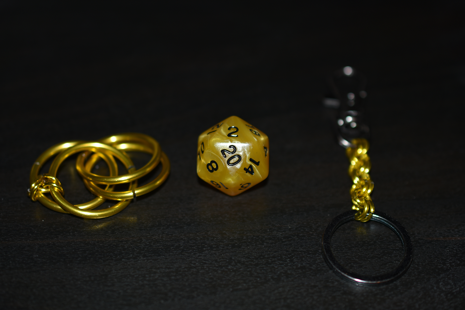 Step 1 - Gather all pieces for the keychain and lay the dice cage out as shown.