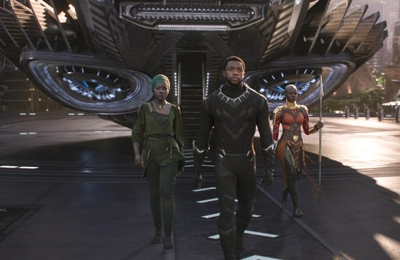 Black Panther - Amanda is joined by new guest Crystal, along with return guests Lucas, Tim, Robb and Keith to discuss the hit film, Black Panther. Crystal has a very unique viewing experience, Lucas is not happy with the way Marvel handles most of its villains, Tim wants to know about Wakanda and the world of Black Panther, Robb proposes several story arcs that could happen in future Black Panther movies, Keith likes the way technology is used in the film, and Amanda is bad at being a girly girl.