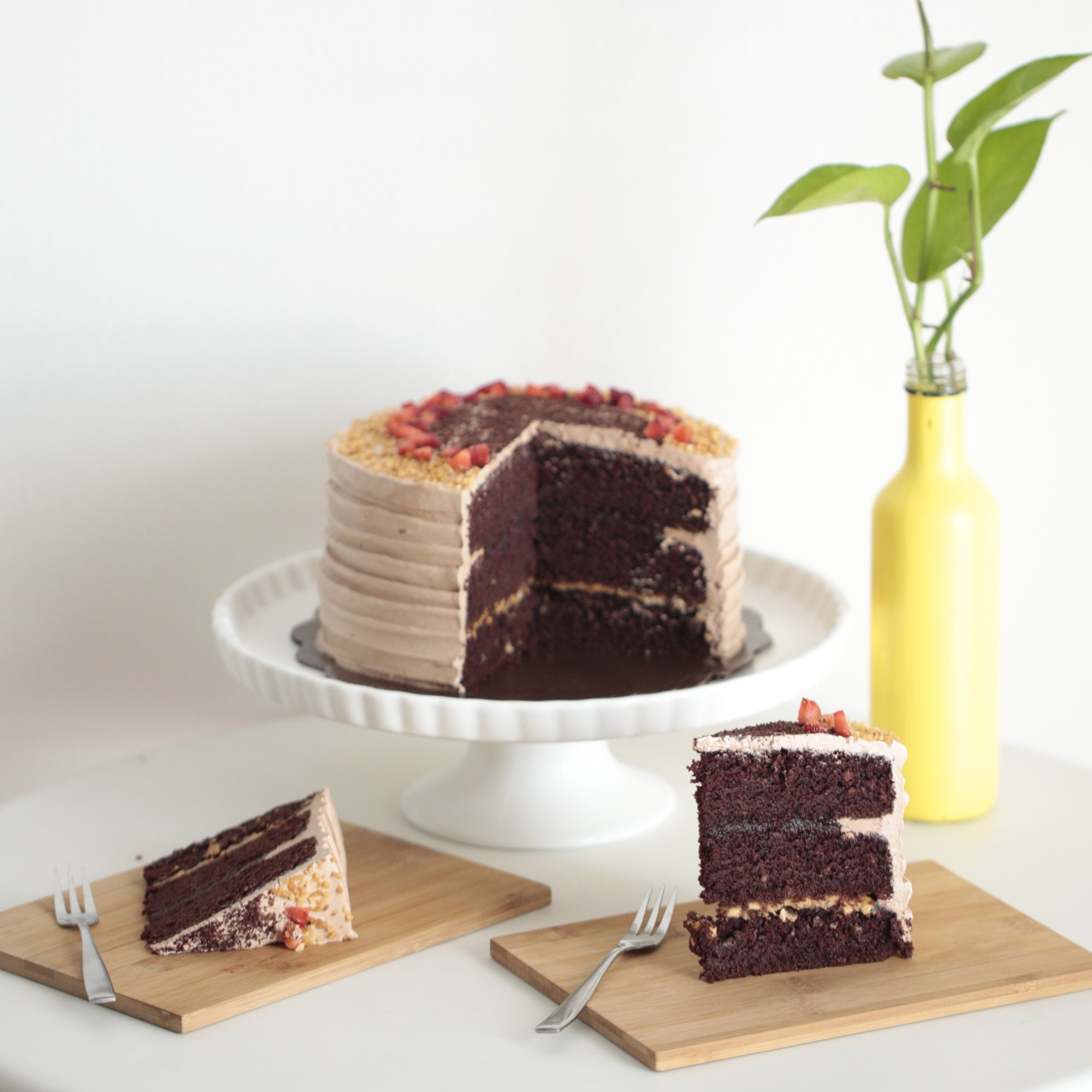 Chocolate PB&J - Ø18 cm - Rp. 300.000,-Ø22 cm -Rp. 450.000,-Ø26 cm - Rp. 600.000,-Extra moist chocolate cake layers filled with strawberry jam and peanut butter. Covered with chocolate buttercream and topped with peanuts, strawberries, and shaved chocolate.