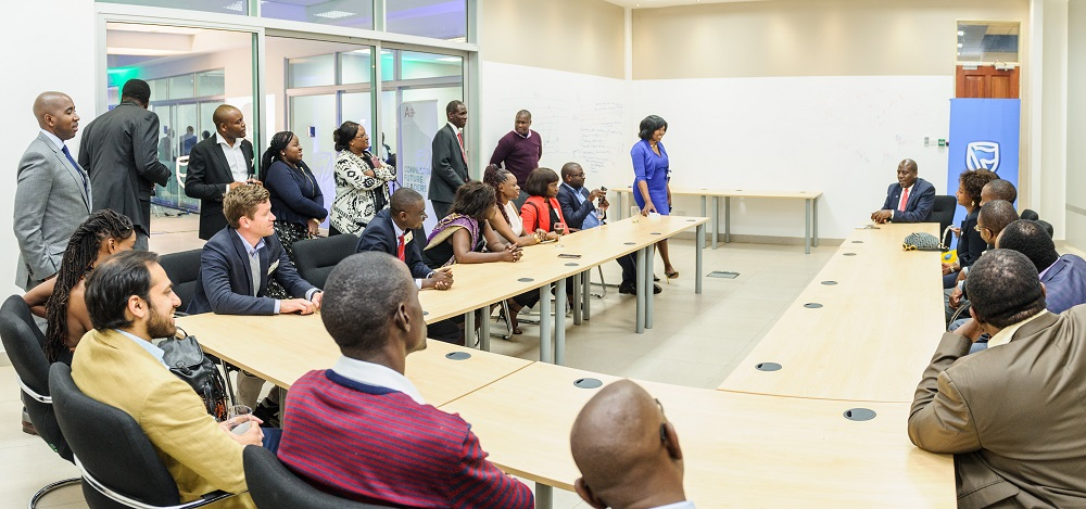 Charles Mudiwa, CEO of Stanbic Zambia with members of The Africa List in Zambia