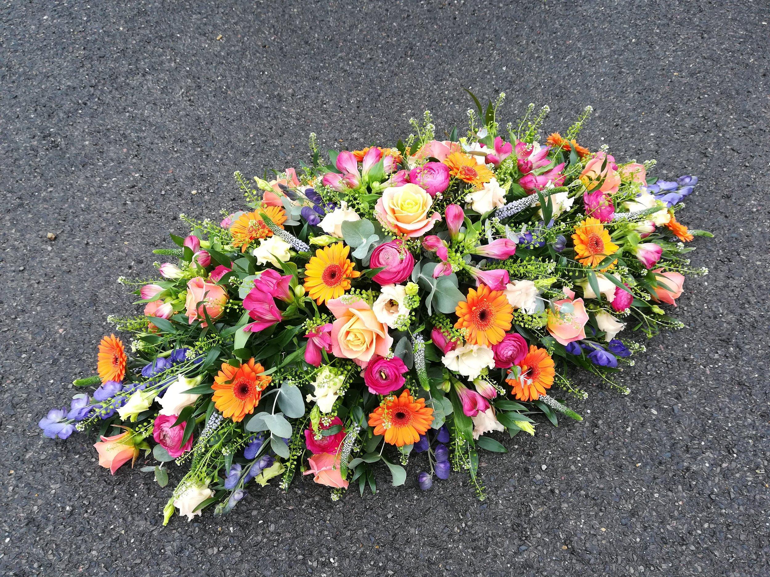 Vibrant Coffin Spray - Miss Piggy Roses.jpg