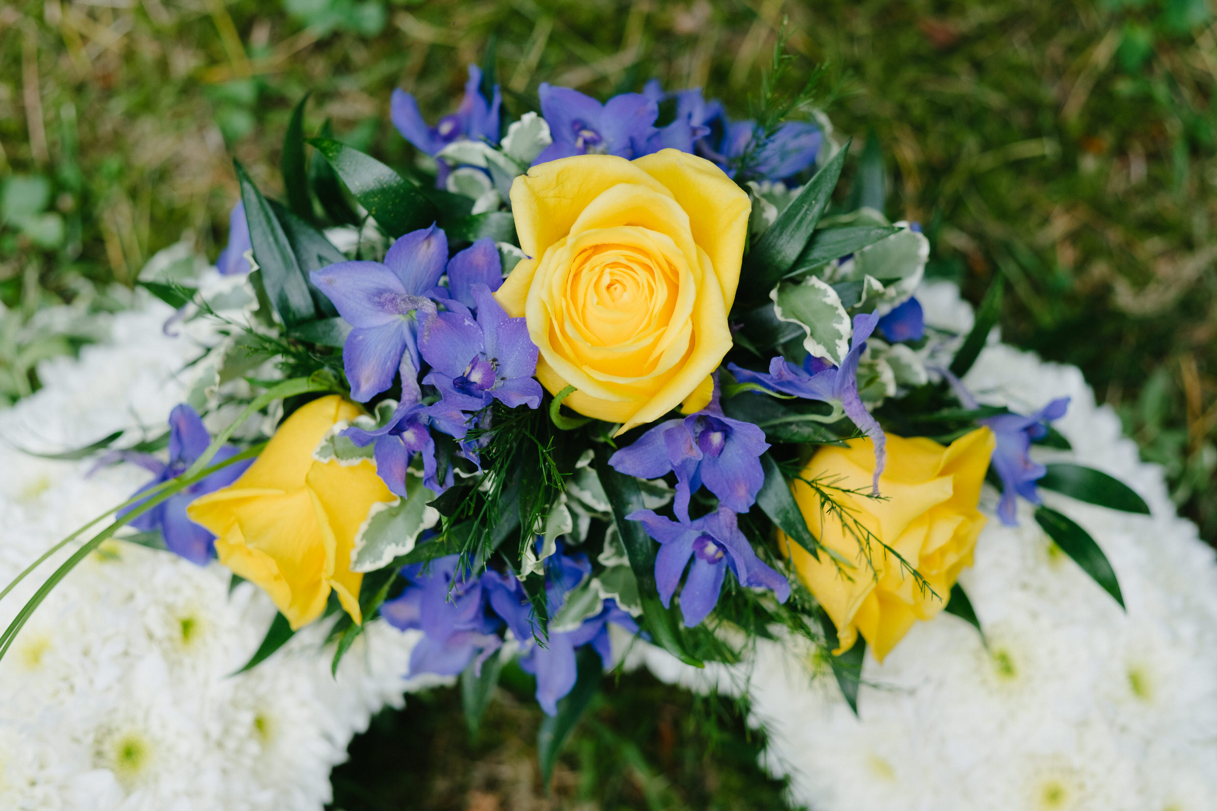 Based Funeral Wreath - Yellow and Blue Spray.jpg