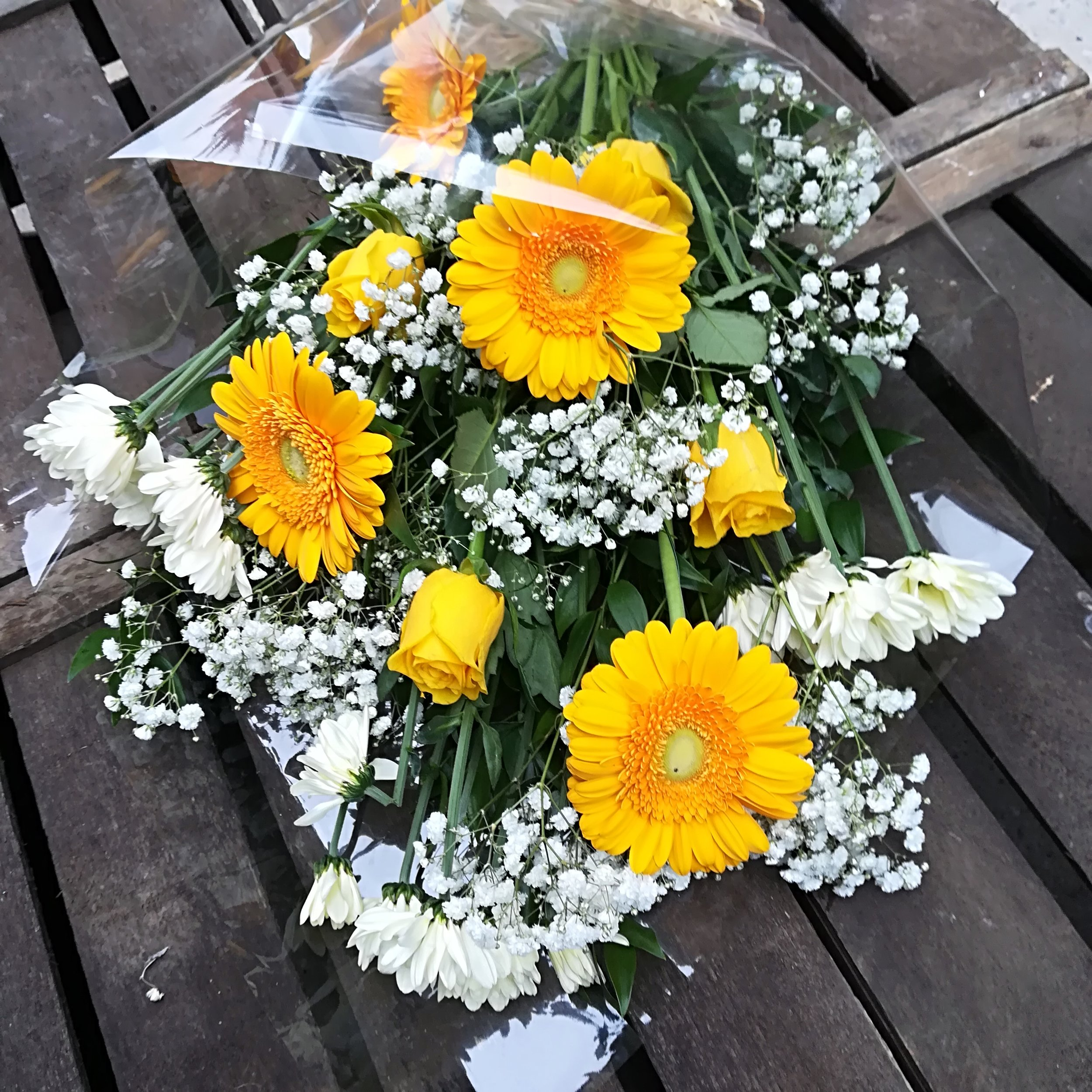 Funeral Flowers in Cellohpane - Yellow and White Inc. Gerberas.jpg
