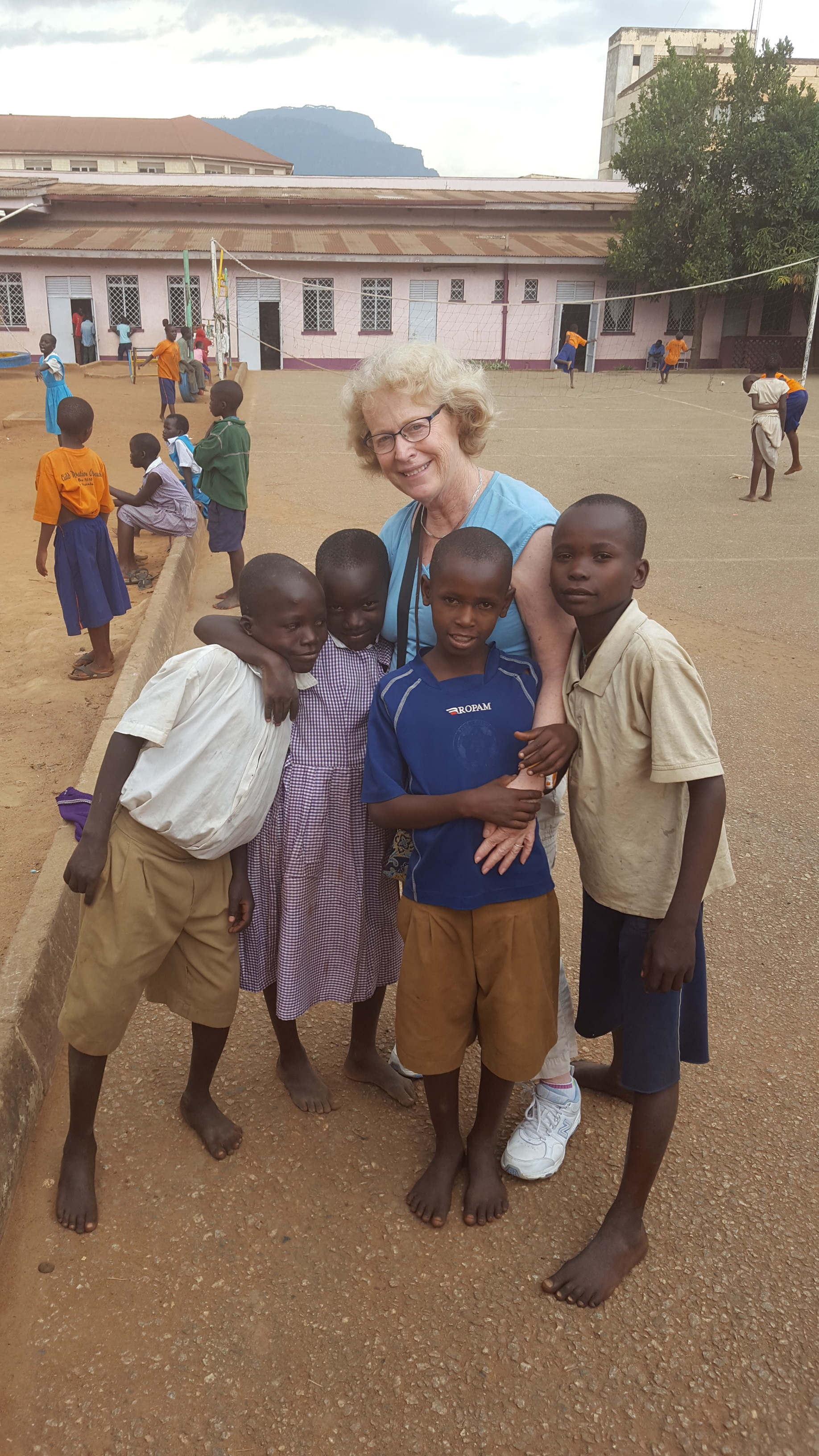 Sally Ryan at the C.R.O. project center in Mbale in 2016 with C.R.O. youth.