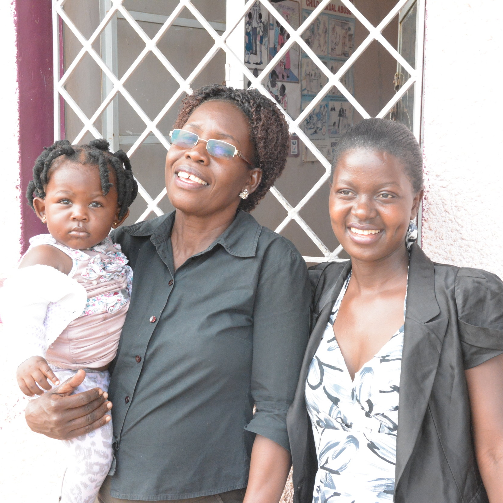 Little Esther, C.R.O. Social Worker Liz, and CROSO Graduate Lydia in 2016.