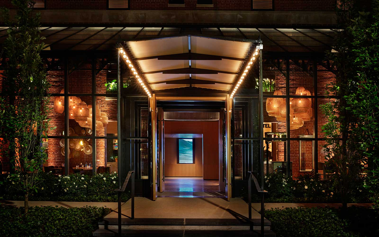 Entrance to hotel at night.