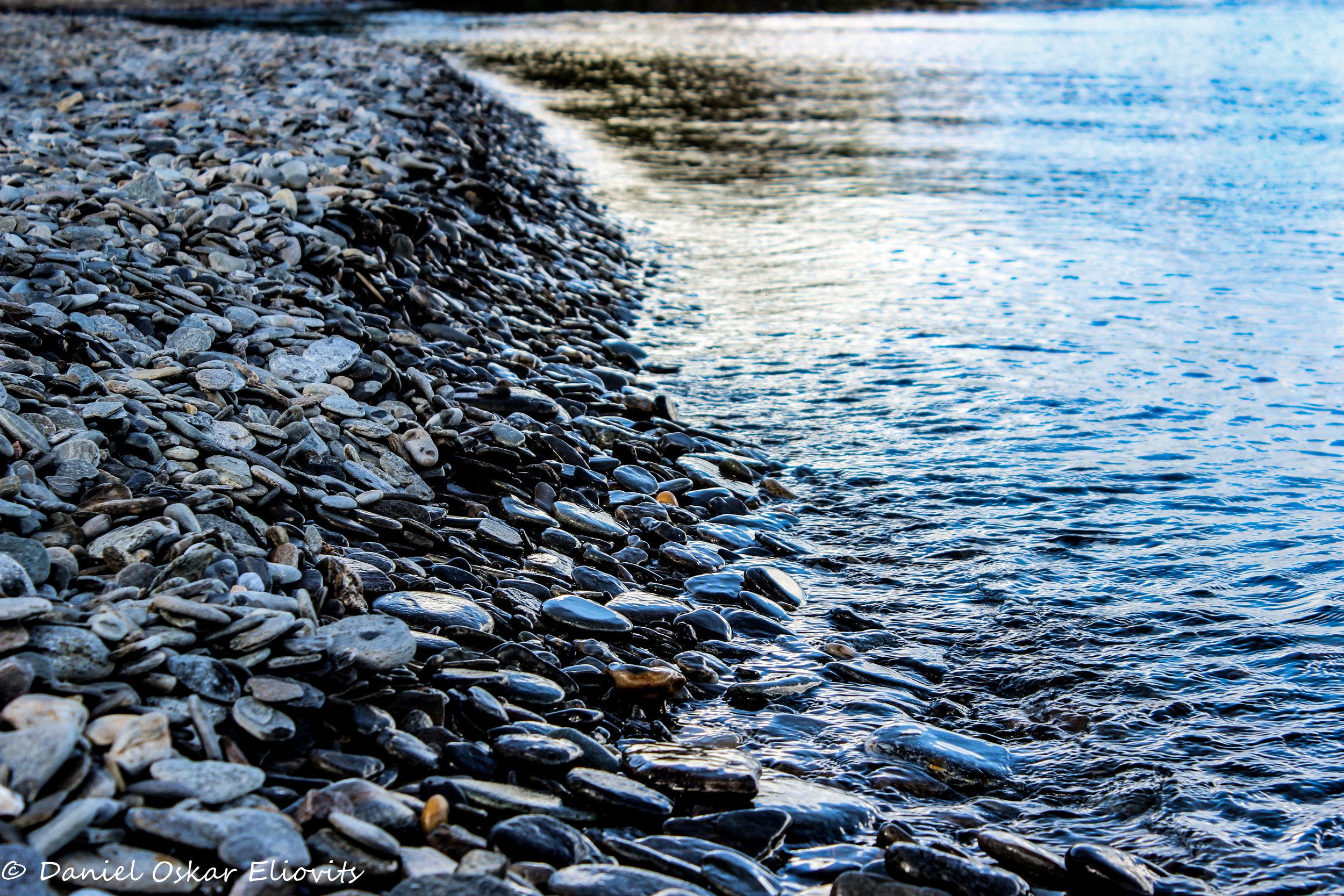 """Lake """"Torneträsk"""" beach in northern Sweden."""