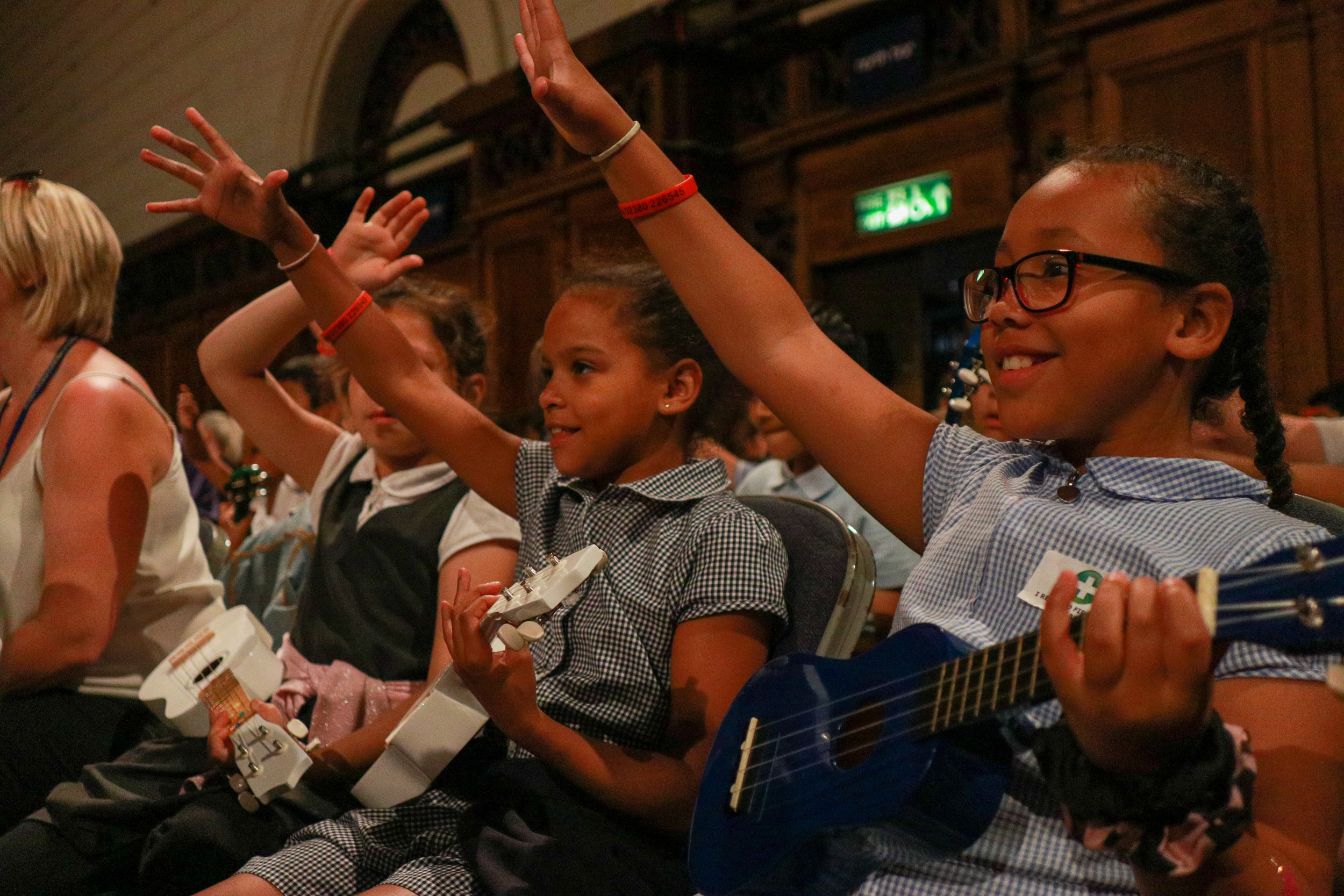 Young ukulele players taking part in a massed playing event alongside 400 others.