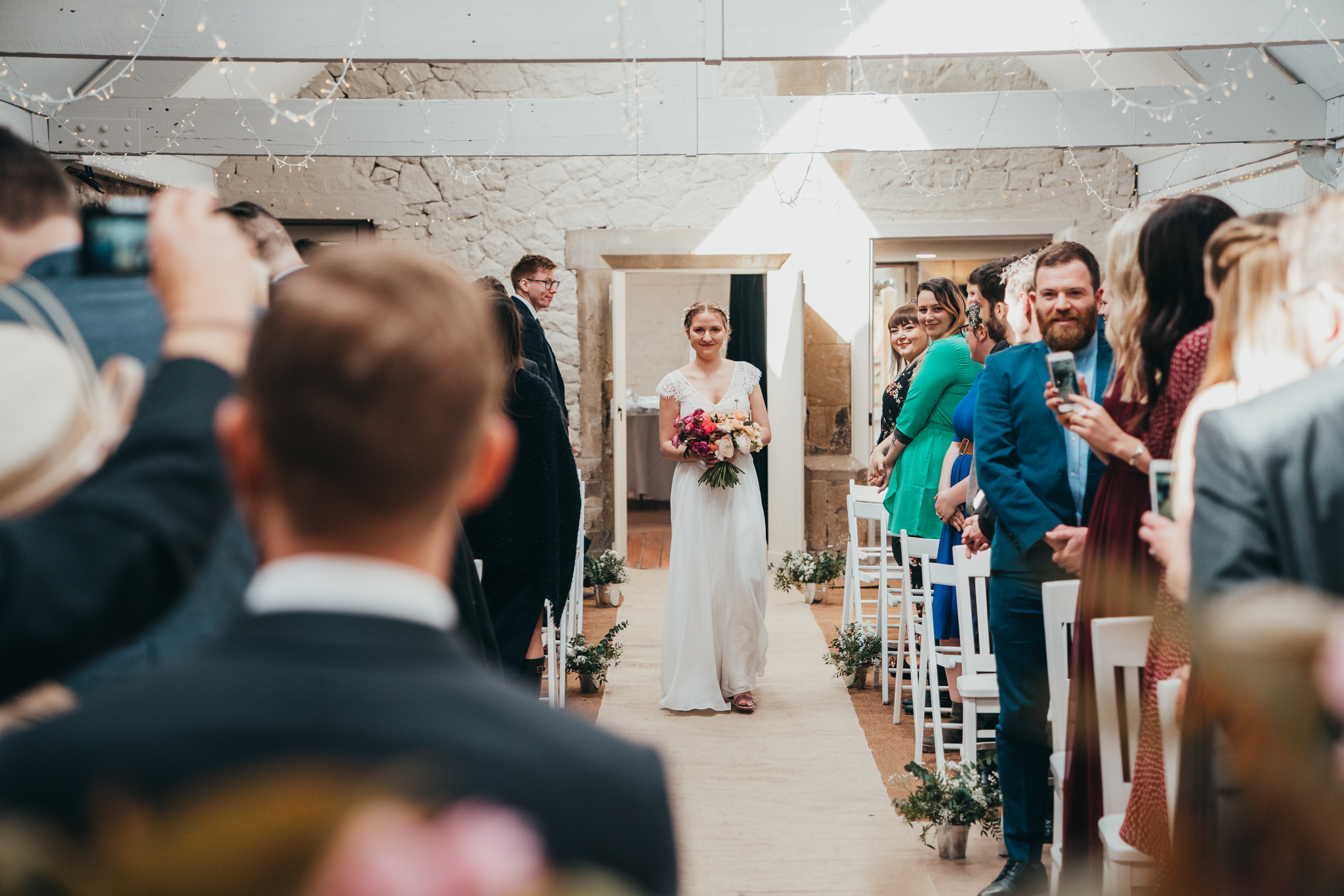 Bride with Flowers Walks down Aisle