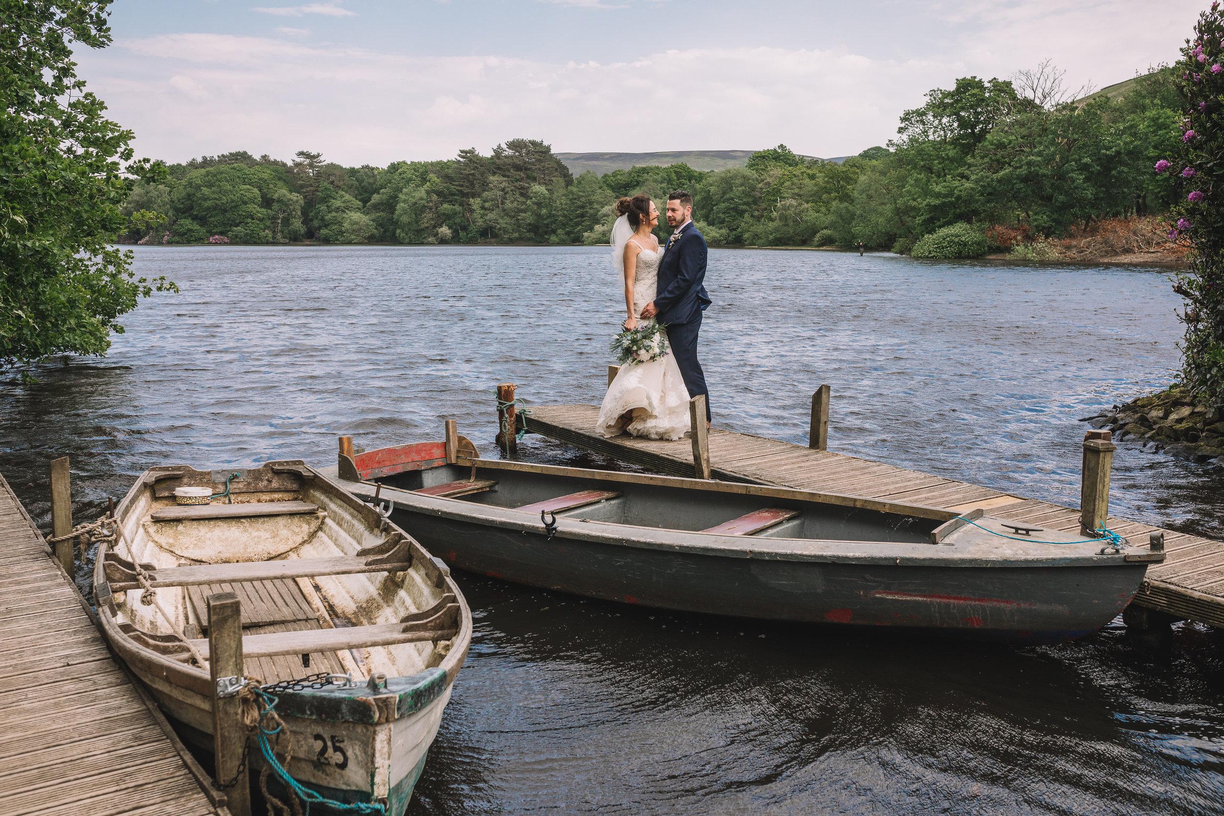 Boating lake wedding kiss
