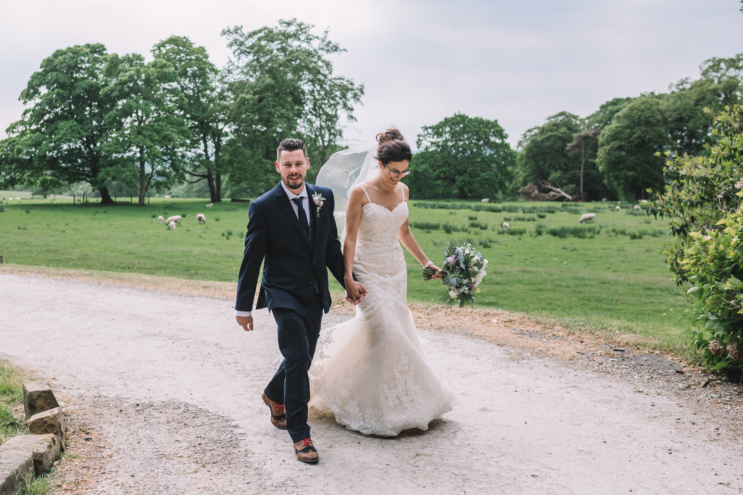Contryside bride and groom walking