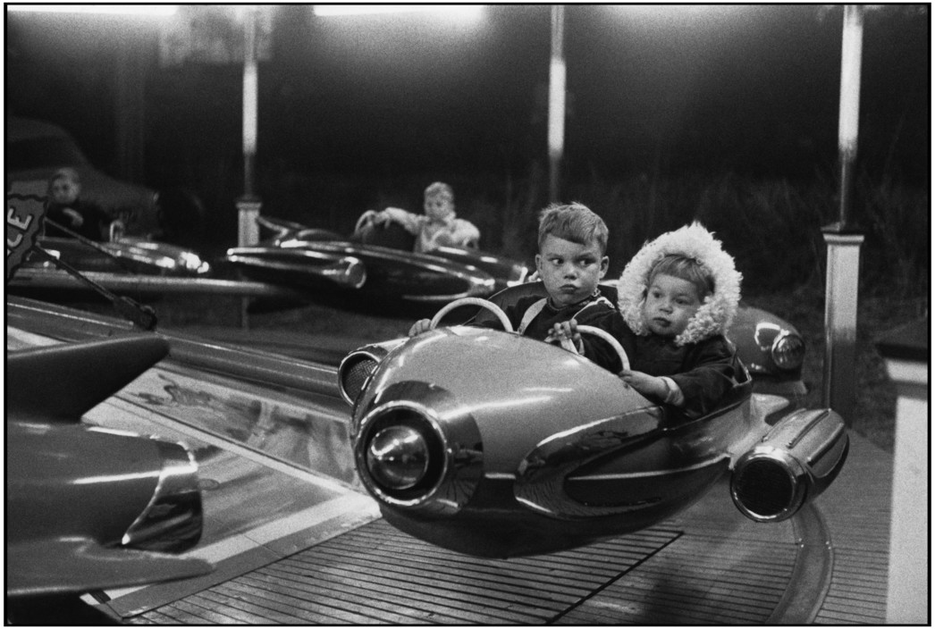 """Cartier-Bresson's """"Amusement Park"""" This is a great photo and many people enjoy it -- but it works outside of """"context"""" -- you likely don't know these kids nor where they are or even when it was taken. And yet: still works.  Are your photos enjoyable even if someone doesn't know you or anything about the image? It's a high bar."""