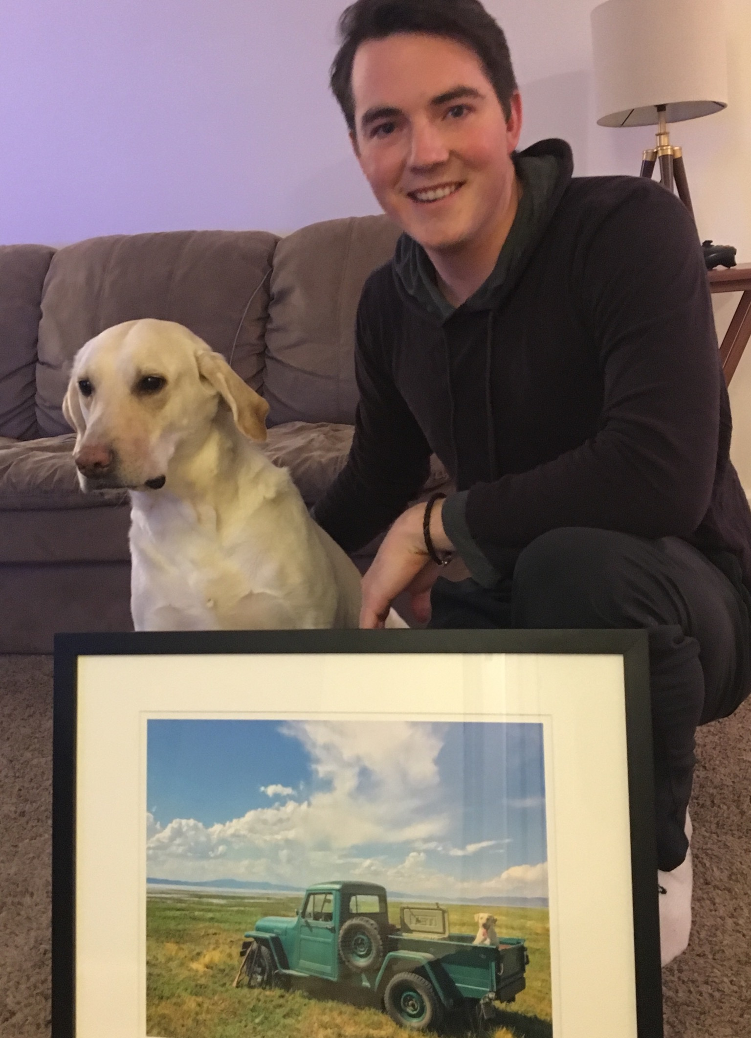 The photographer and his model, Stetson, with his framed print (photo by Carolyn Fluehr)