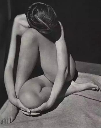 Nude in Doorway (1936) by Edward Weston (of his girlfriend Charis Wilson)