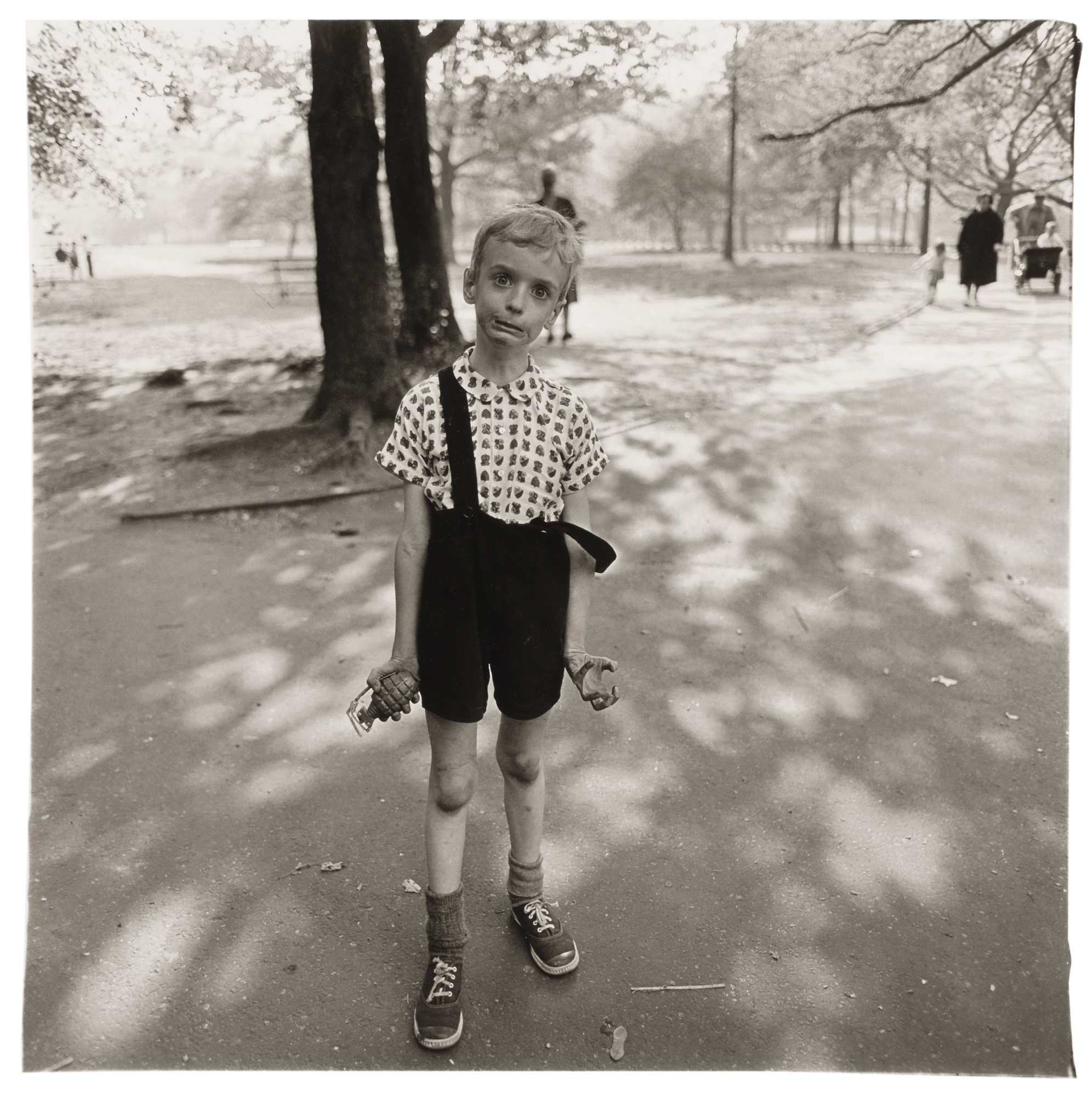 Child with a toy hand grenade in Central Park, NYC, 1962