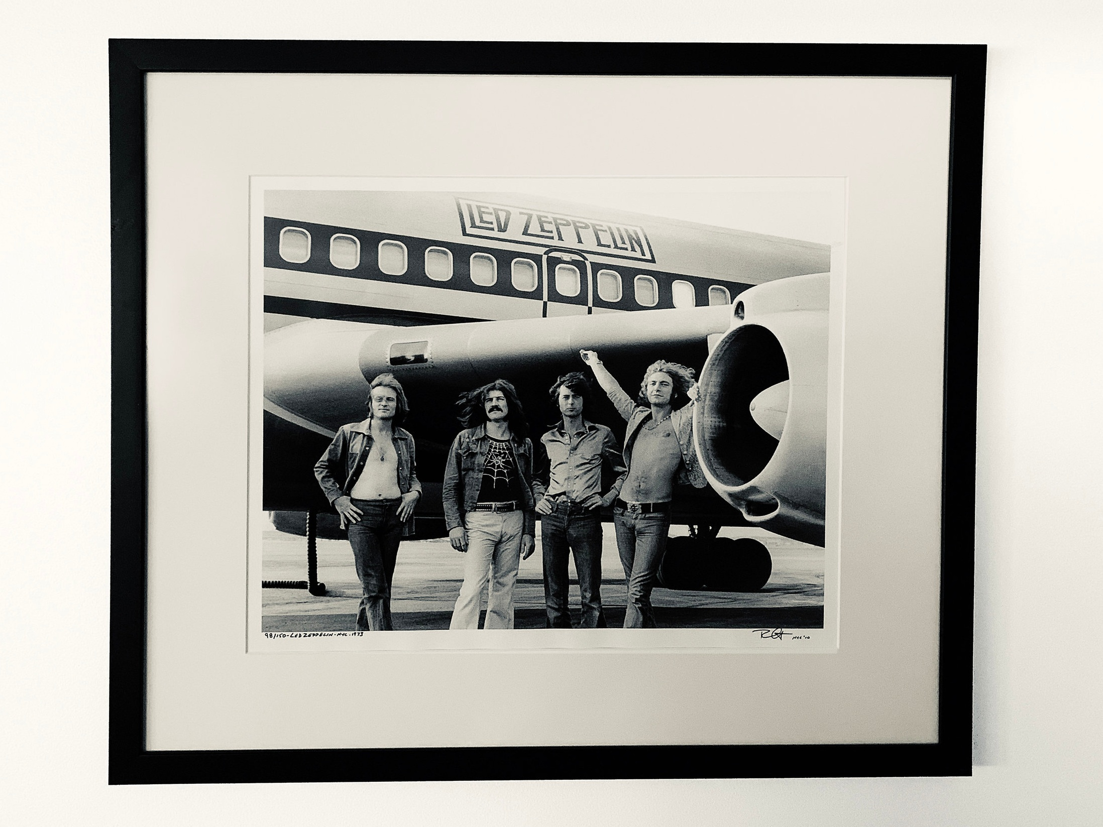 "Bob Gruen, ""Led Zeppelin/Jet"" (1973) John Paul Jones, John Bonham, Jimmy Page and Robert Plant of Led Zeppelin arriving at the Teterboro, N.J., airport en route to a 1973 gig in Pittsburgh."
