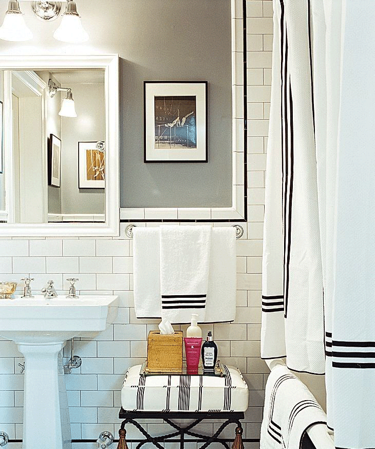 Geometric details. - Add nuances to bathrooms and wash rooms. Like the black-and-white tile floors and clean-lined black picture frames in this bathroom bring a graphic touch to a colorless bathroom.