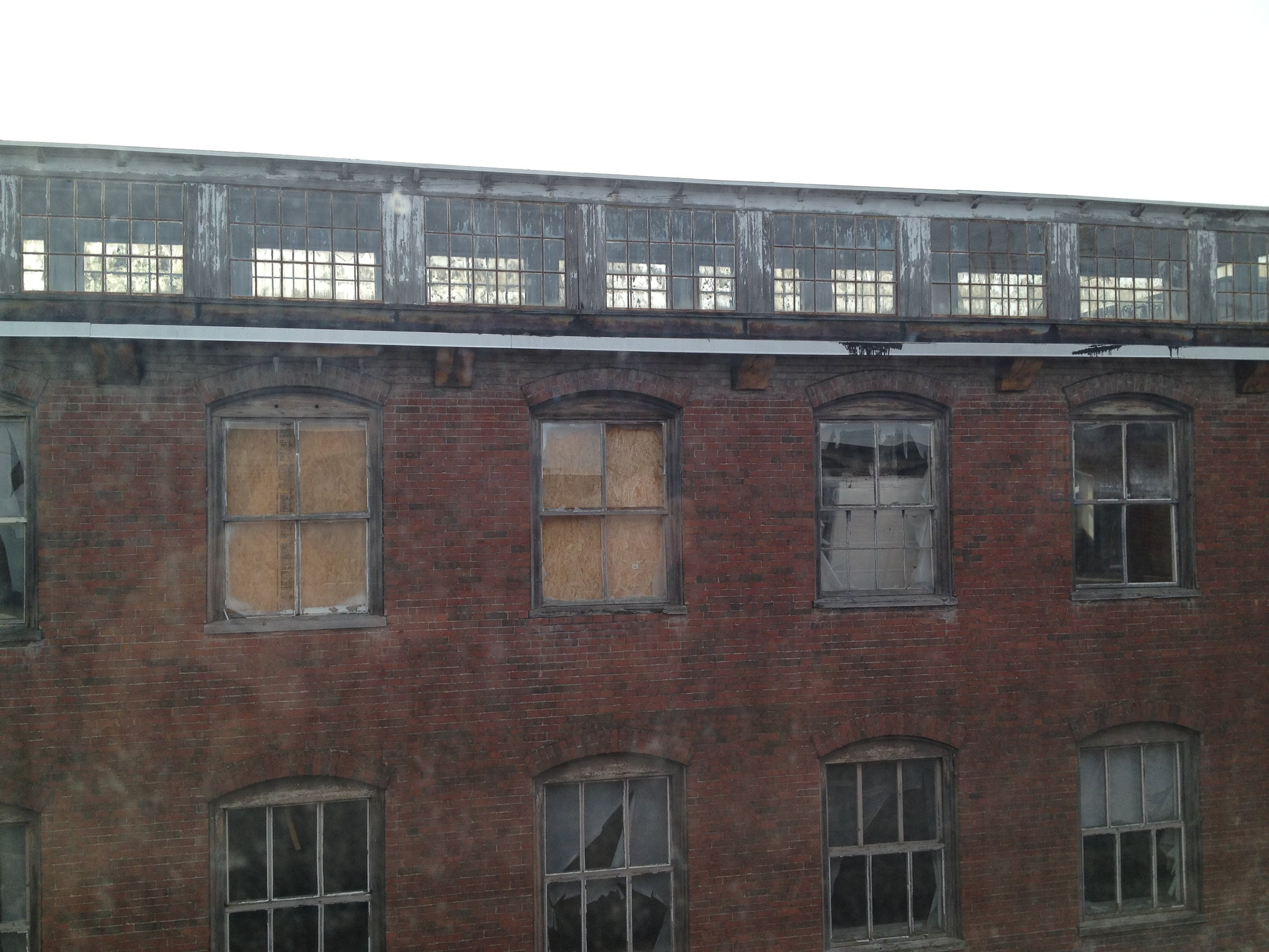 Broken windows and rotting wood frames.JPG