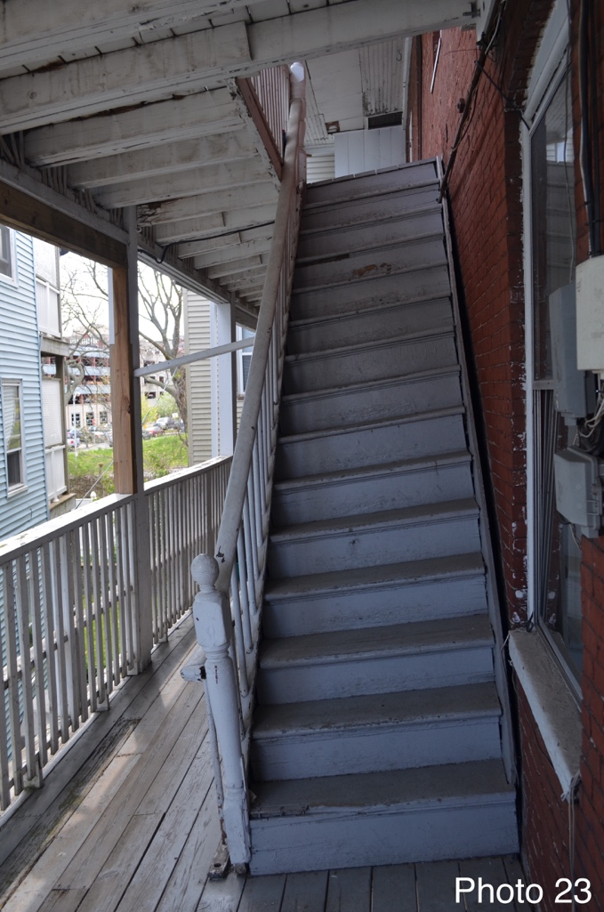 5 Sloping back staircase on porch.png