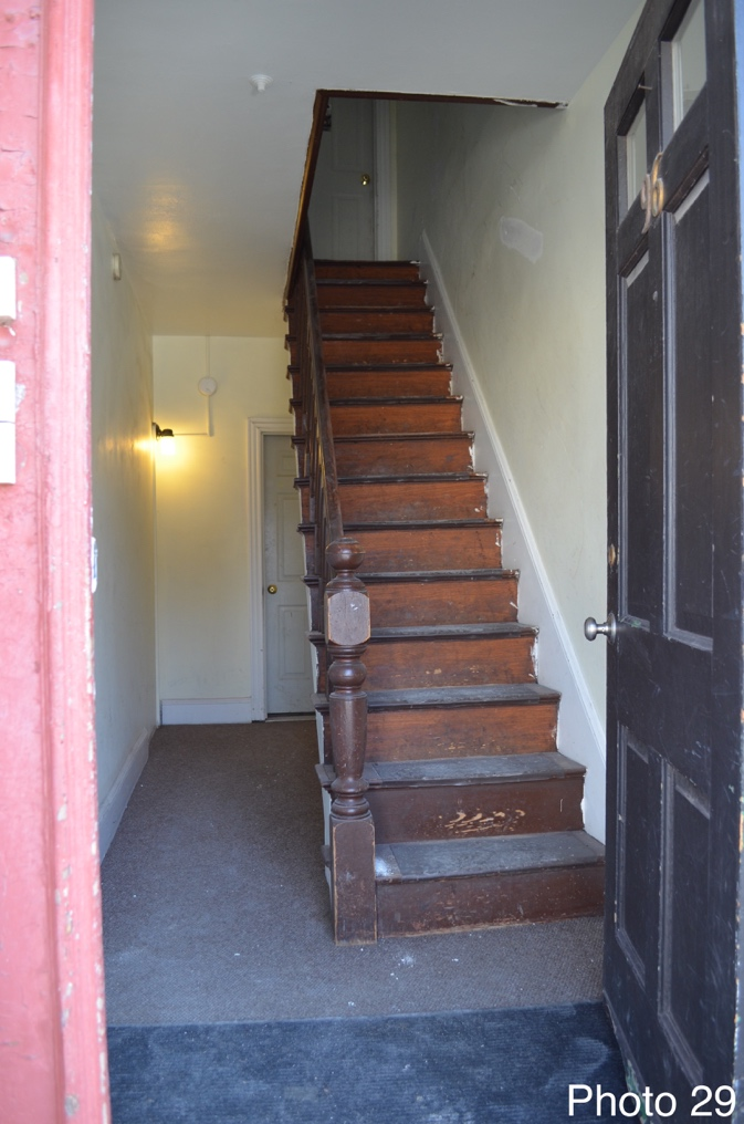 6 Front entry and central staircase.png