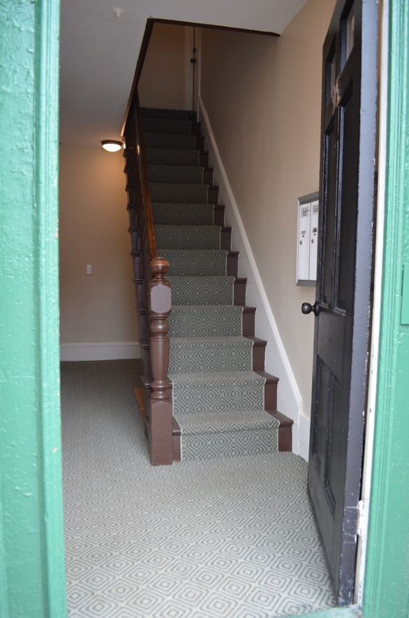 17 Front entryway and central staircase after.png
