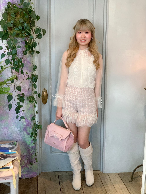 Top: Rasmile; shorts: Lily Brown; bag, boots, earrings, hair clip: All LIZ LISA.