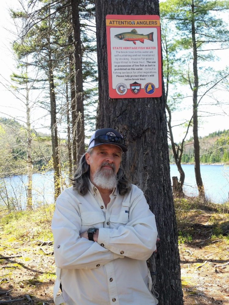 Native Fish Coalition National Vice Chair, Maine board member, and founding member Bob Mallard with the first State Heritage Fish sign posted. June 2018, Misery Pond, Misery TWP, Somerset County, Maine.