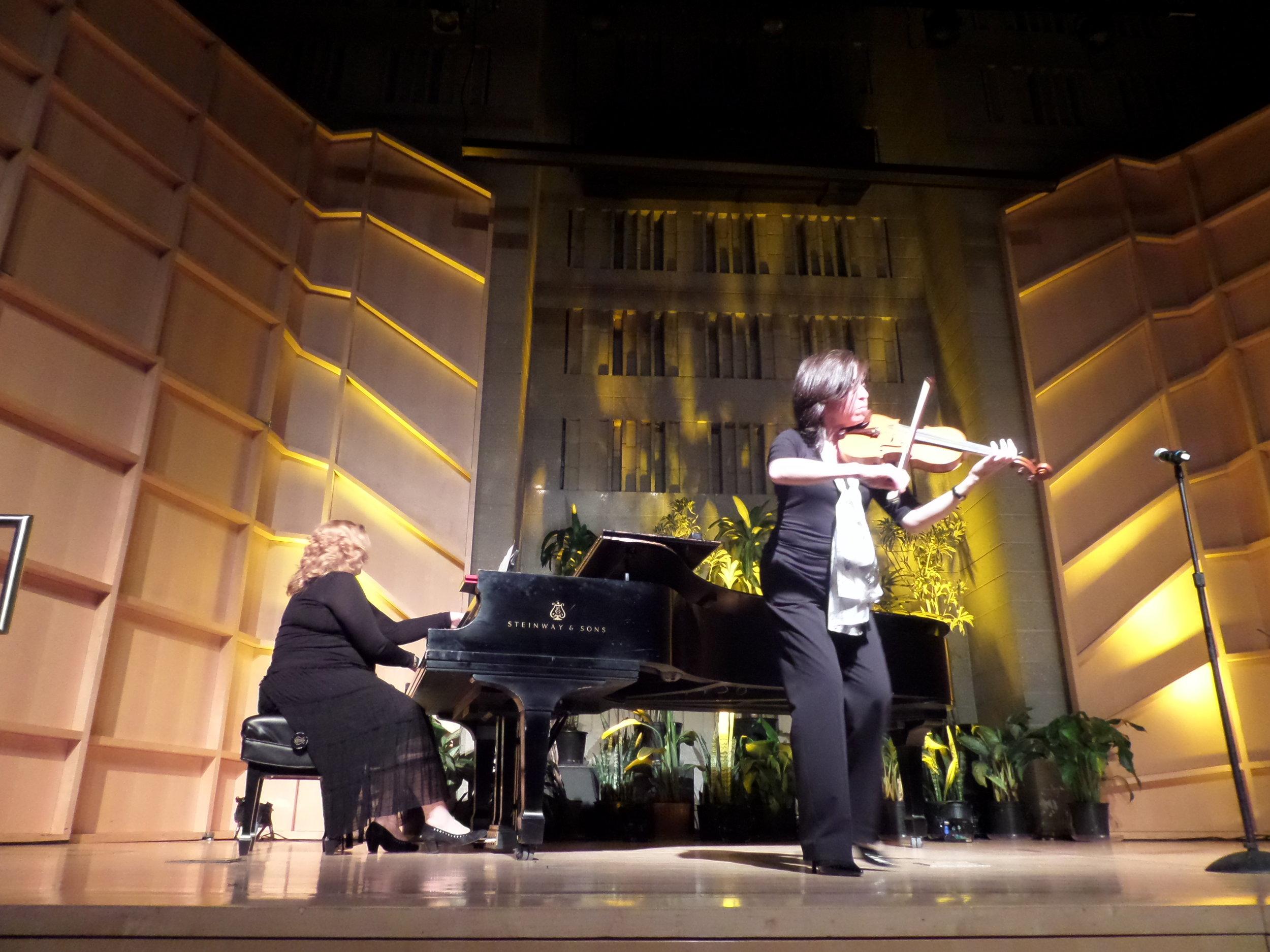 SKY CARAVAN - Milena Davidowicz, Violinist & Elena Panova, Pianist perform before the film  THE WHISPERER by Andrea Odezynska.