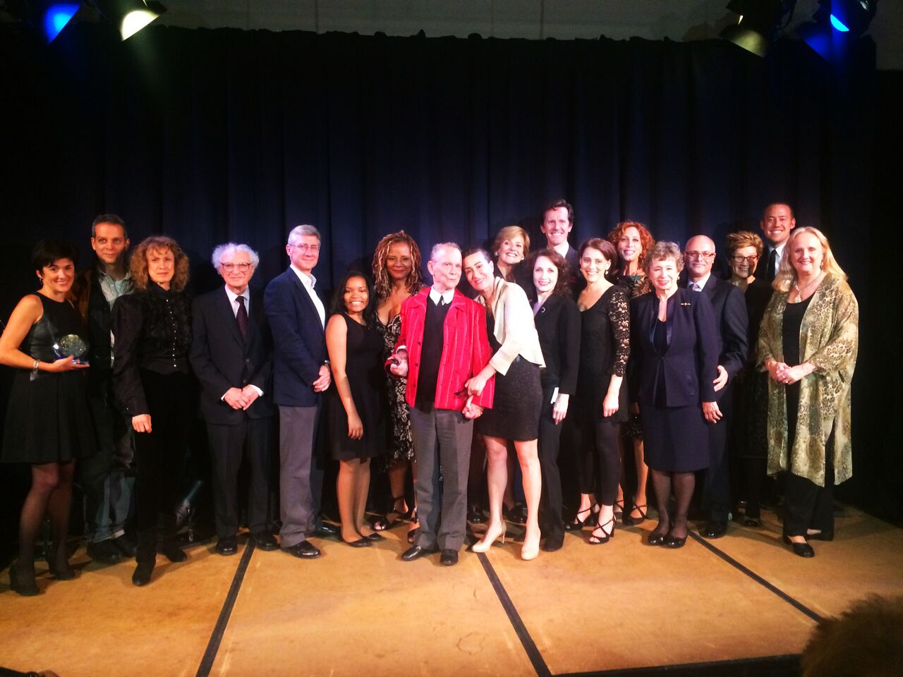 Joel, Jeanine & Adelaide surrounded by performers and board.jpg