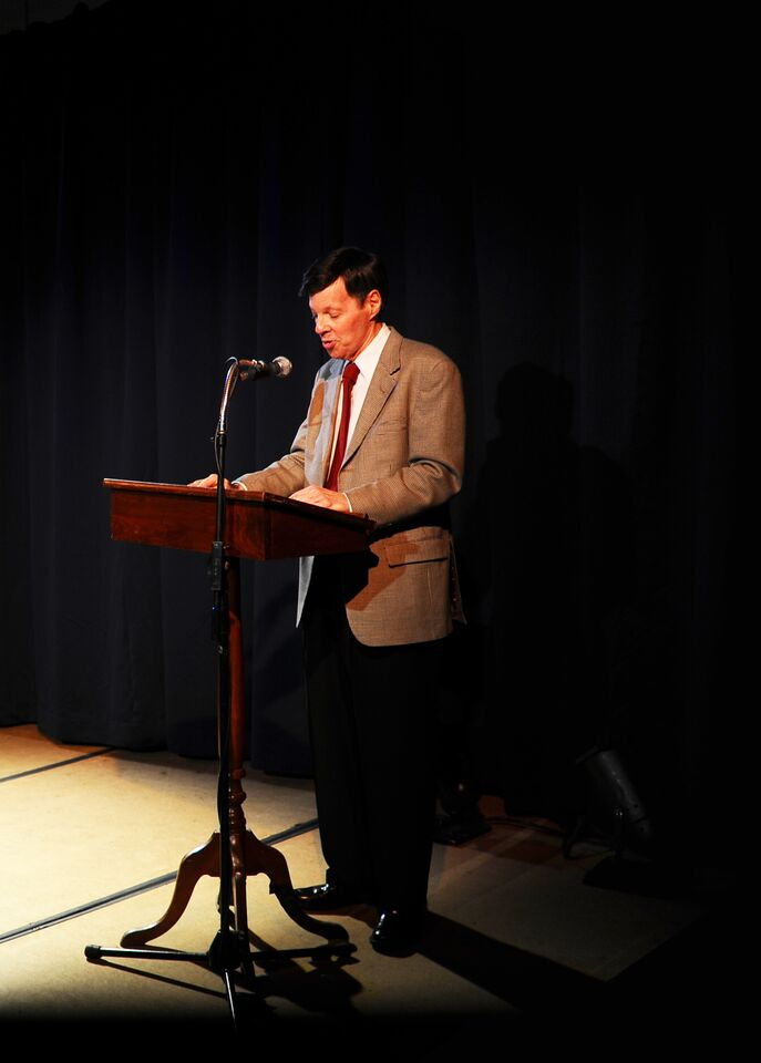 Michael Kerker at podium.jpg