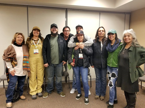 April 7, 2018—Winona LaDuke (third from the left) and Muriel YoungBear (center)gather with other indigenous hemp leaders for a picture at the NoCo Hemp Expo in Loveland, Colo. (Image: Sarah LittleRedfeather)