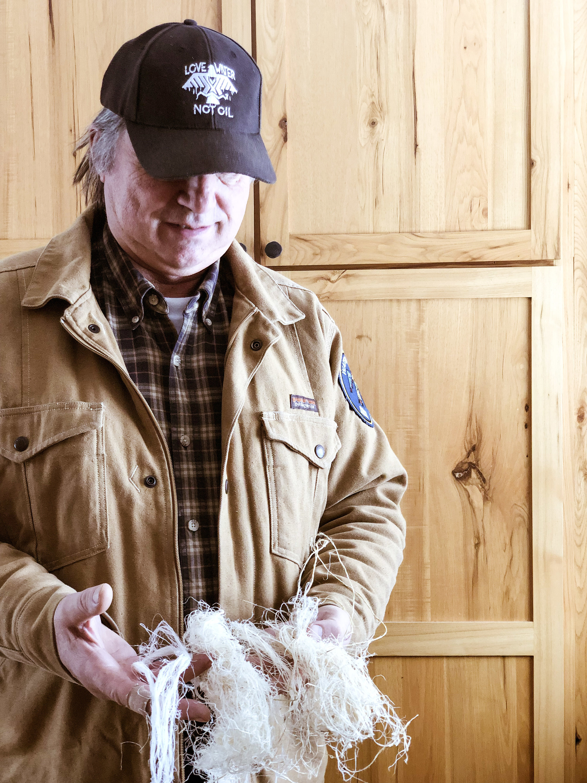 Don Wedll wearing   Patagonia   with   Honor the Earth's   hemp hat. Don here holding decordicated hemp fiber which he hand processed. It is a very strong fiber, stronger than cotton.