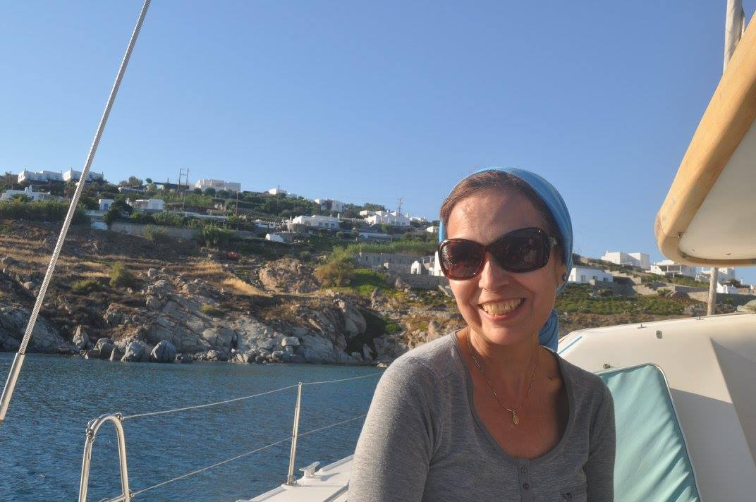 A catamaran day brings smiles to Maricela in Greece.