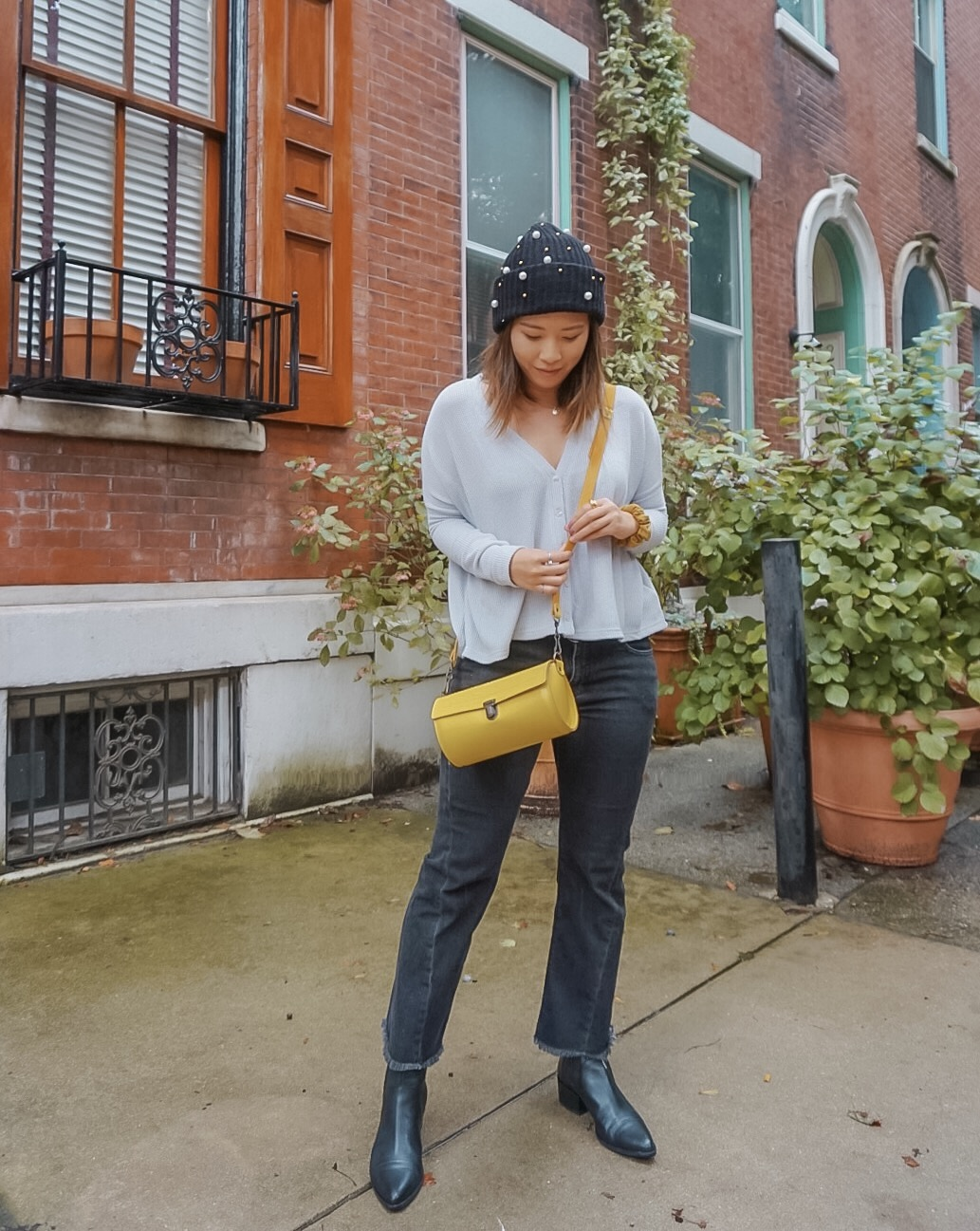 UO Courtney Cardigan  // Mid-Rise Cropped Bootcut Jeans ( Similar Here ) //  Vegabond Marja Cap Toe Bootie  (More Affordable  Here )// Nasty Gal Pearl Beanie (Affordable & Similar  Here ) // Yellow Crossbody (Similar  Here )