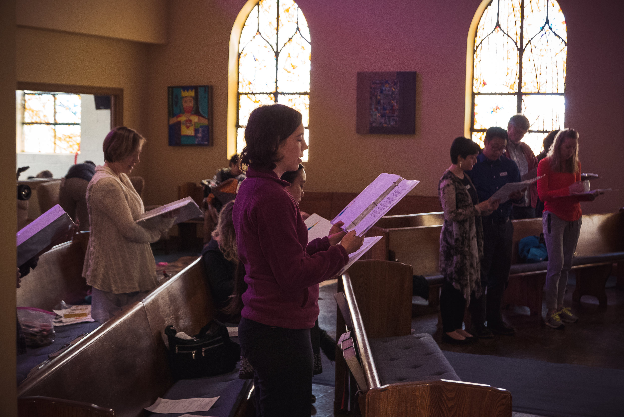 The congregation singing during worship service at Columbia City Church of Hope in Seattle, WA.