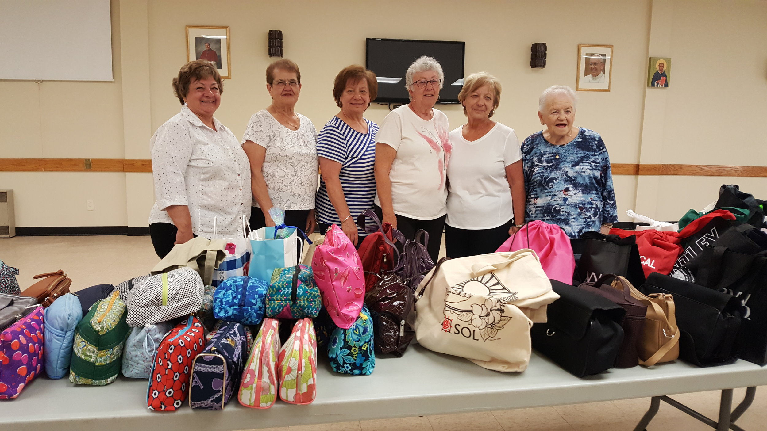 C.W.L. Hug Project 2019  The C.W.L. Executive would like to thank everyone who donated so generously to our HUG PROJECT.. We were able to fill 87 purses and varied sized bags with personal care items for women and children who are victims of domestic abuse and homelessness. We were also able to donate 4 very large bags with clothing and toiletries.  In addition, we had monetary donations and gift cards. The total of these will be divided between Faye Peterson Transition House for Women, and Beendigen Inc.   Thank you everyone again for your generosity!  L.Burella