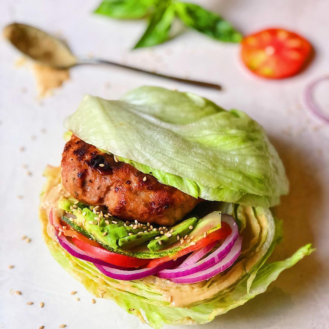 Served here on iceberg lettuce buns with tahini, tomato, cucumber, red onion, and avocado. Feel free to put it on a salad, or between  #sweetpotatoast !