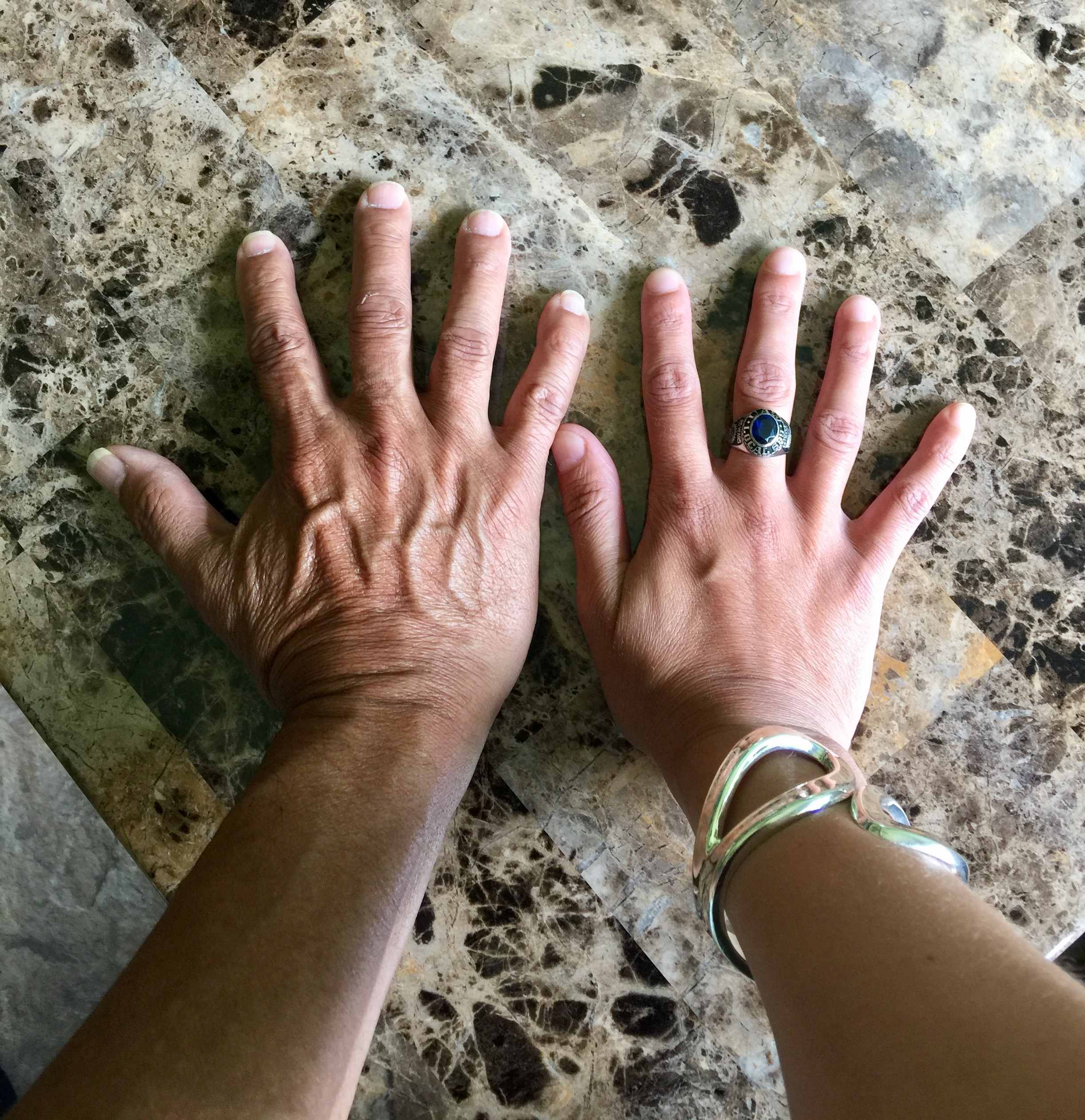 My hand with my father's hand. My father is my first reader.