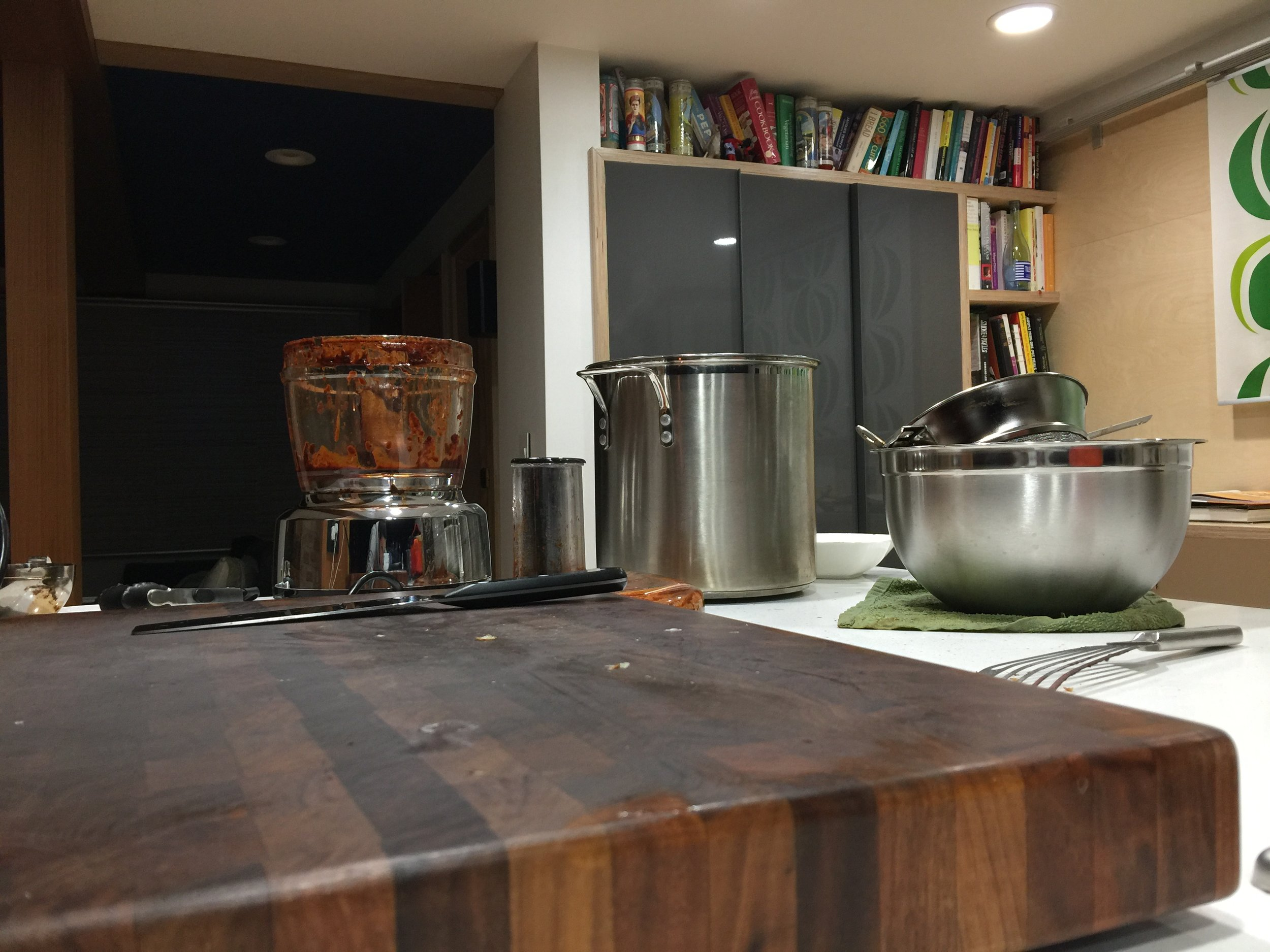 My kitchen and my favorite built-in bookshelves that my husband Todd made for me. I am making mole.
