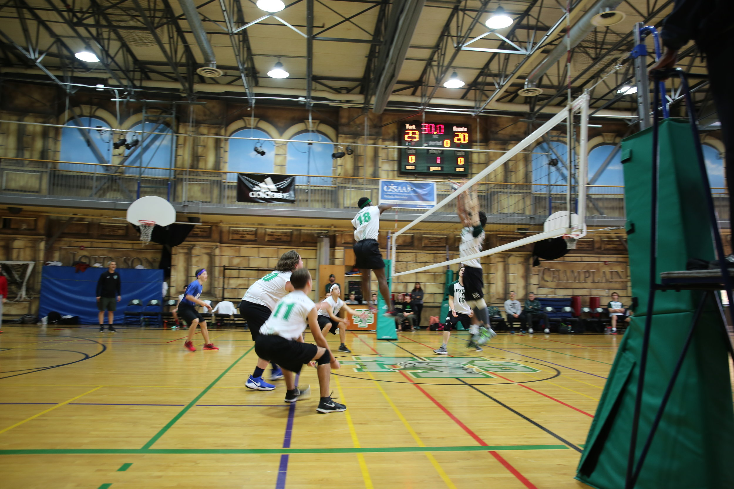 Our Varsity Boys Volleyball team in action!