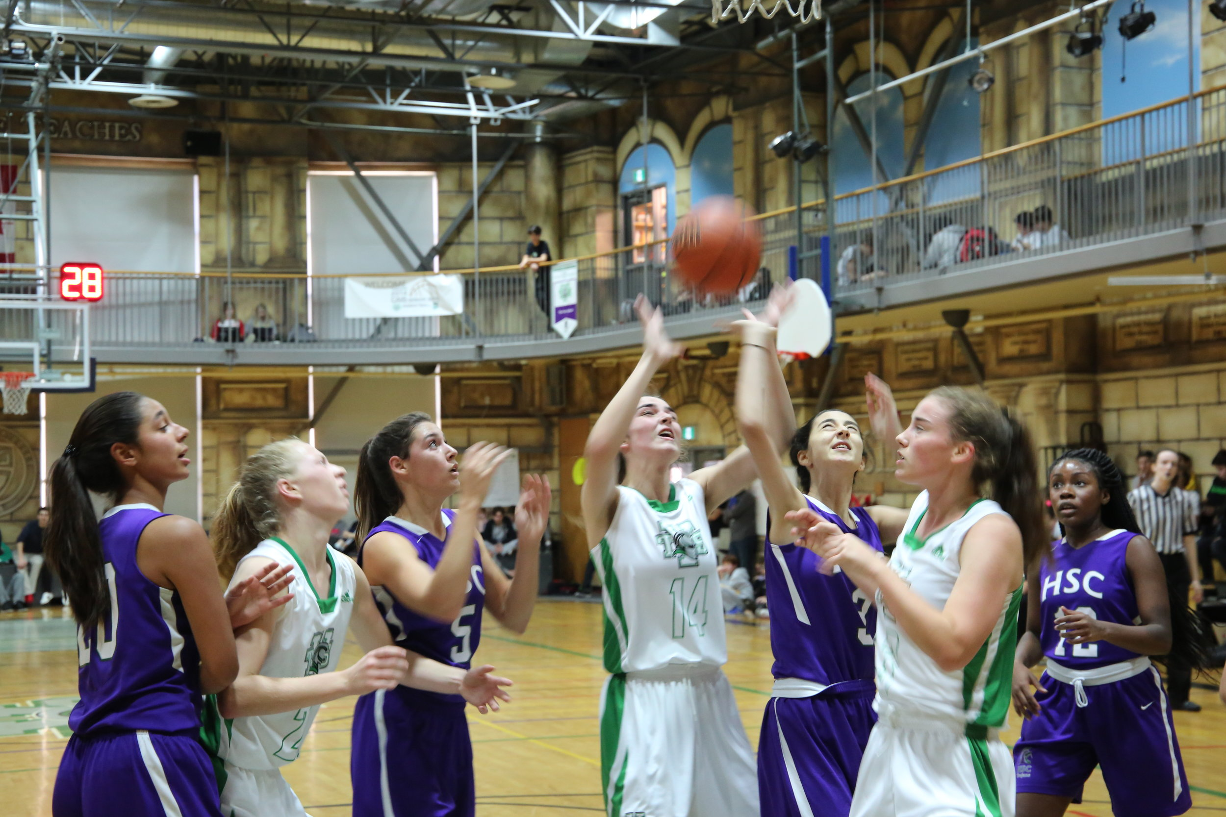 Our Varsity Girls' Basketball team on the court.