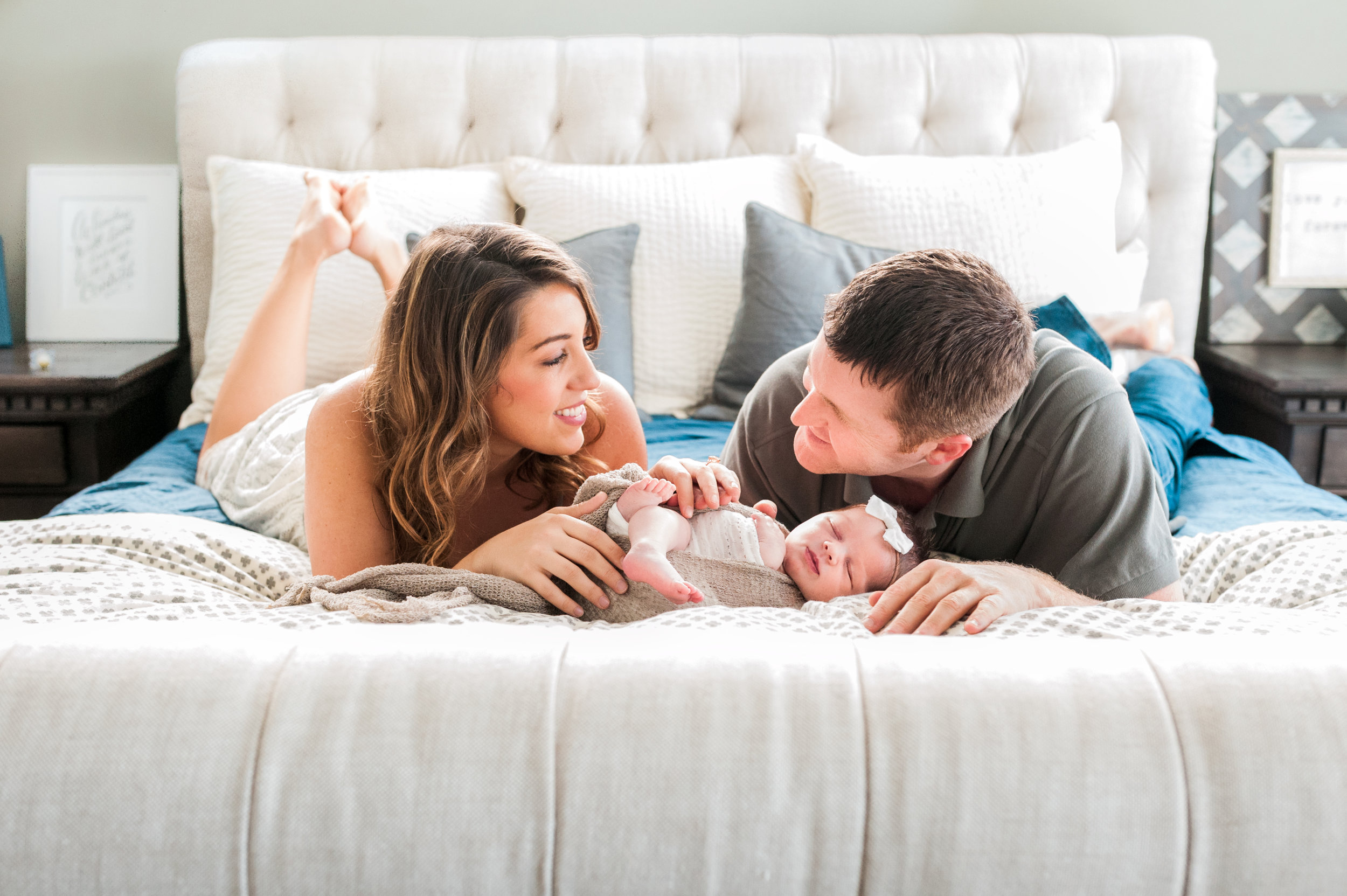 This Houston, TX in-home newborn lifestyle session was full of beautiful natural light, modern neutral tones, and plenty of love for baby girl!