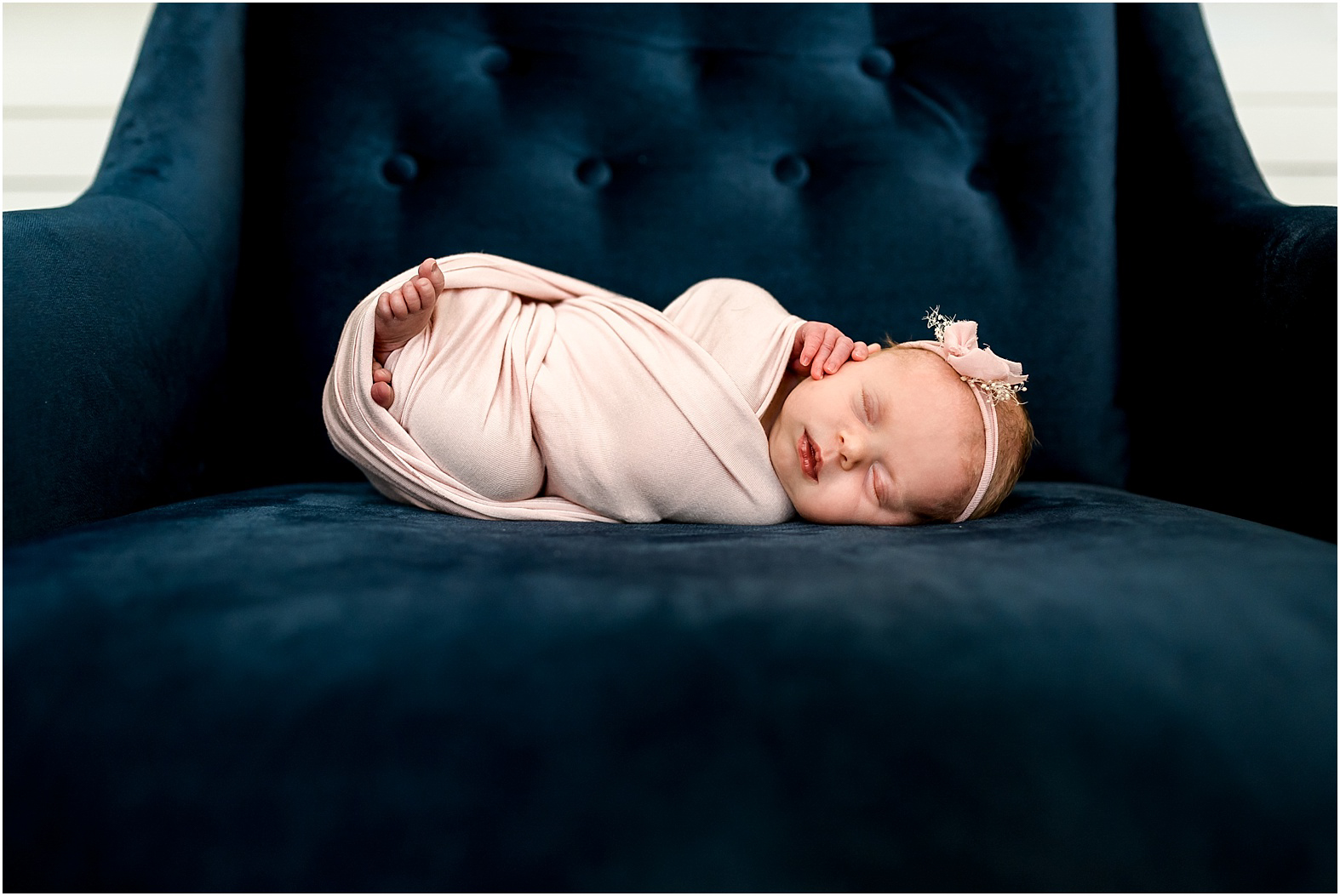 Houston, TX Newborn Photographer Dear Marlowe Photography | Modern, clean, baby girl session with pink, gold, and navy touches. The perfect navy chair props baby girl for my favorite shot ever!