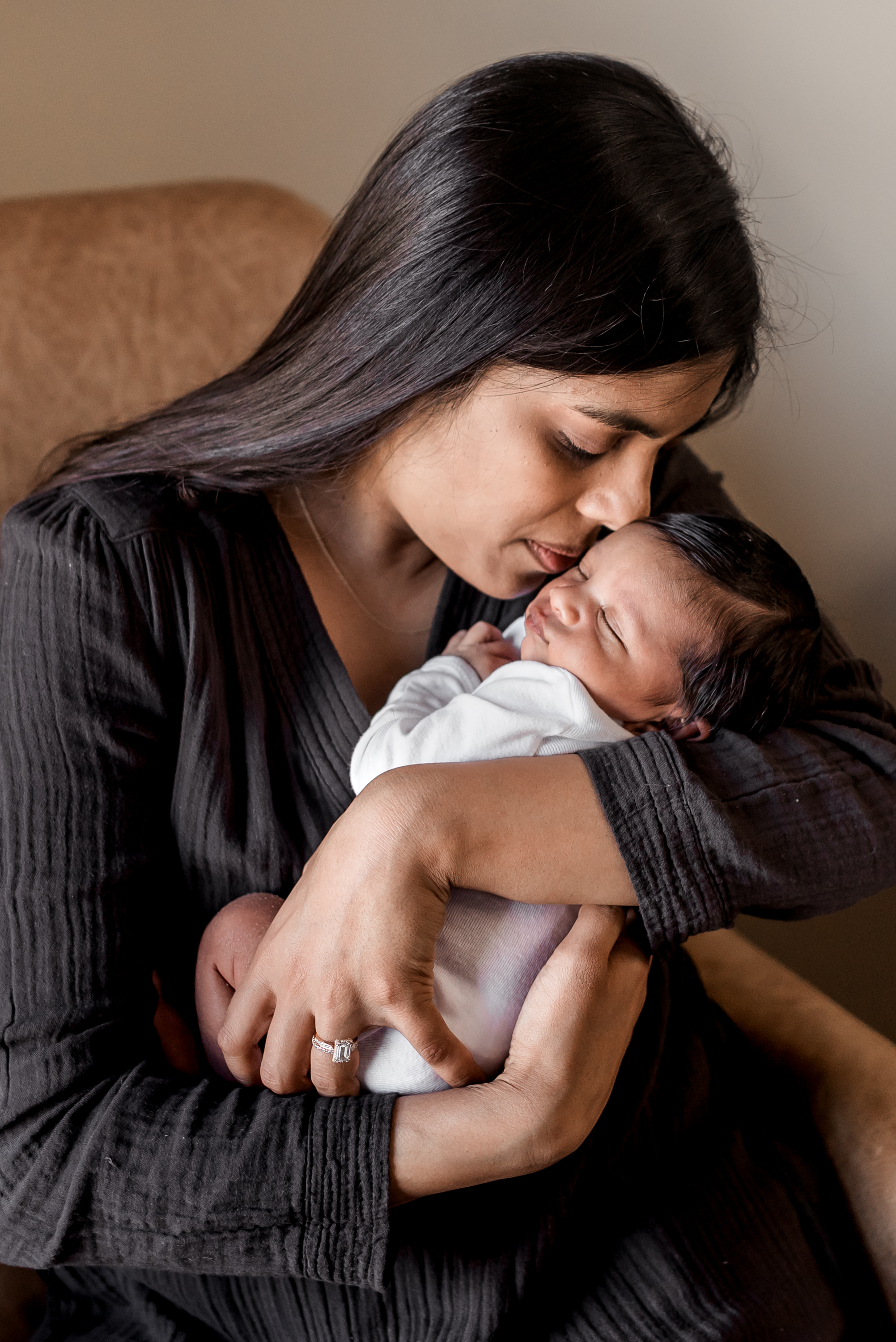 In home Houston Newborn Session with modern touches, boho accents, and vibrant colors.